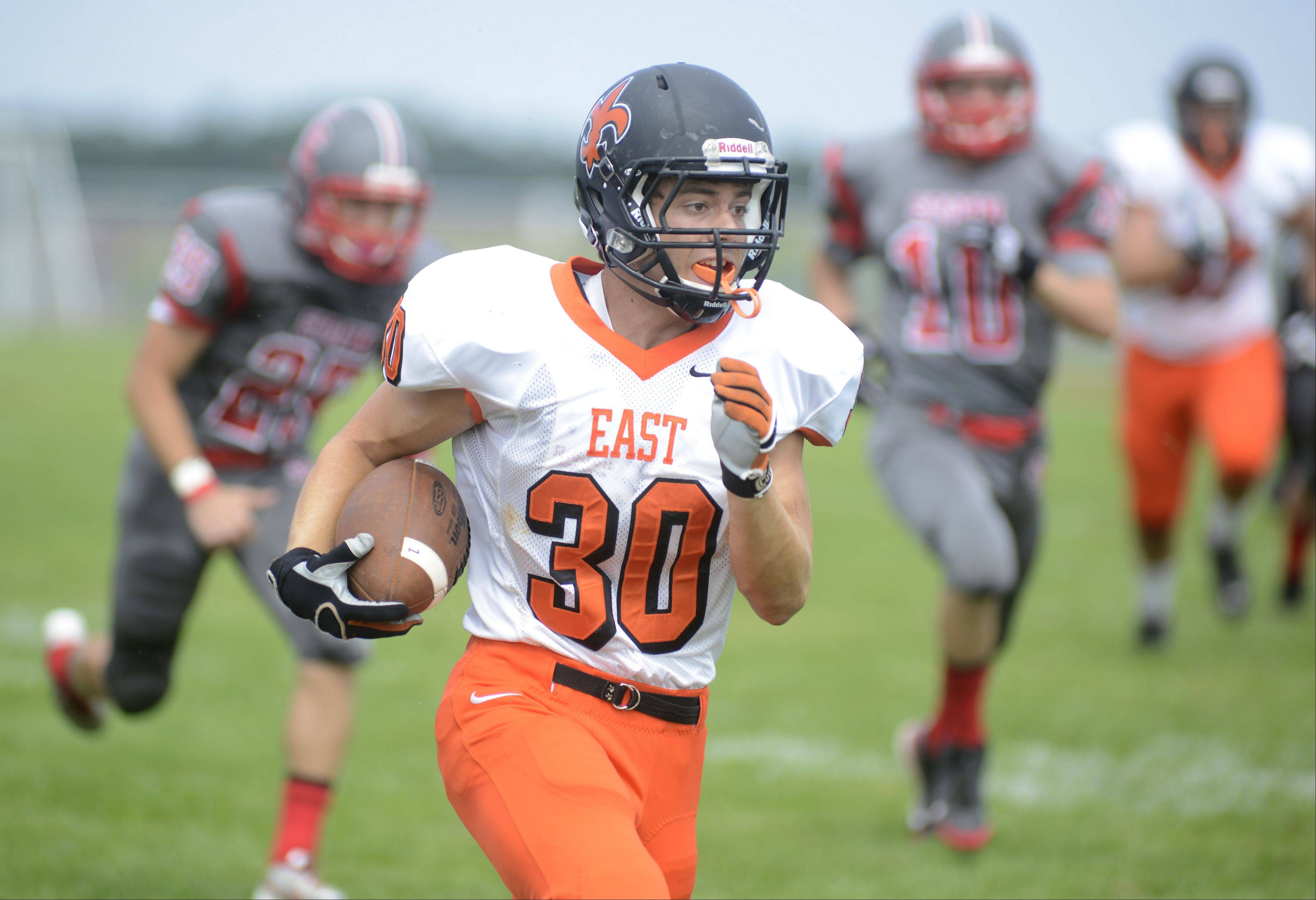 St. Charles East's Mitch Munroe runs down the sideline on his way to making the first touchdown of the game in the first quarter vs. South Elgin on Saturday, August 31.