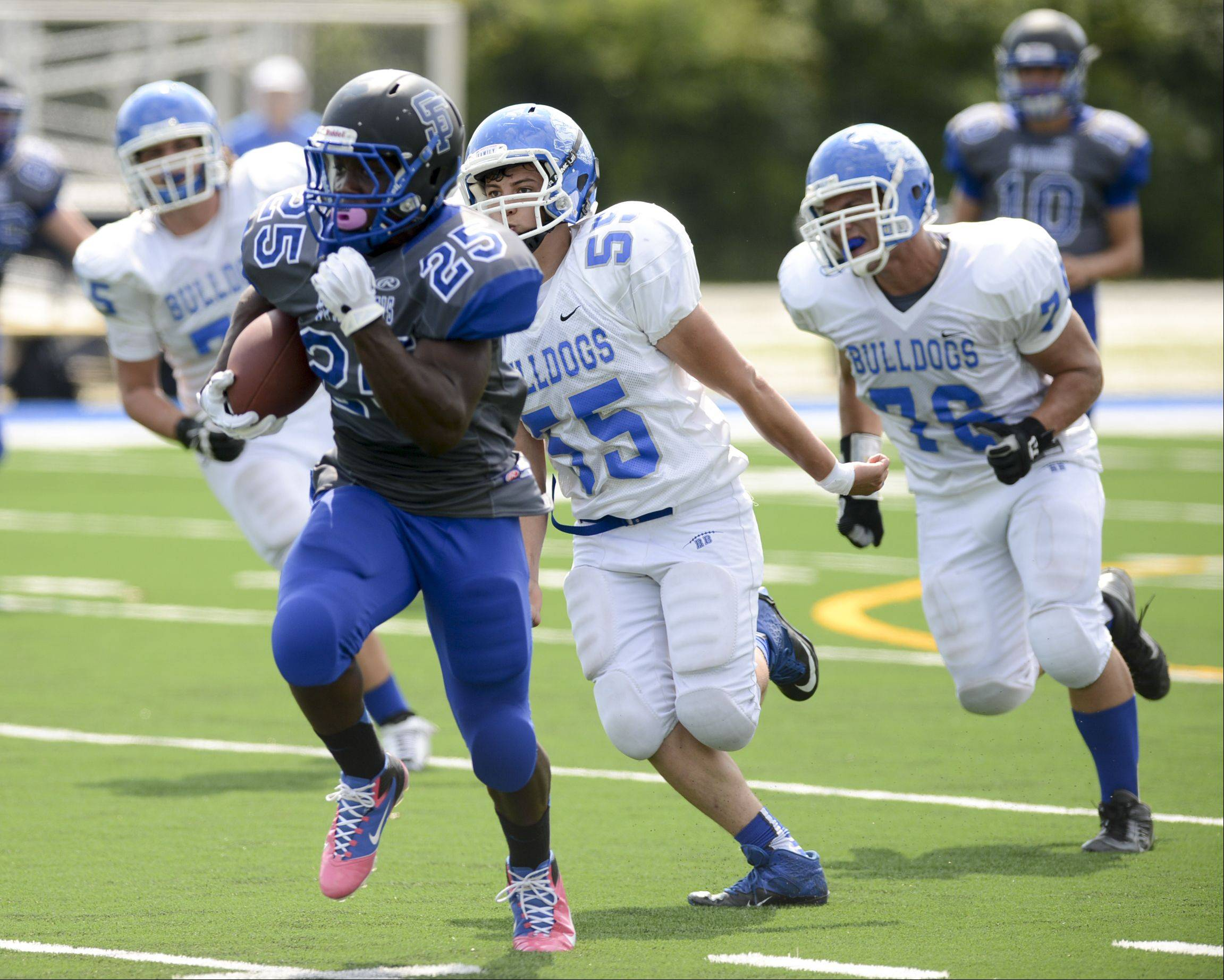 Images from the St. Francis vs. Riverside-Brookfield football game Sunday, September 1, 2013.