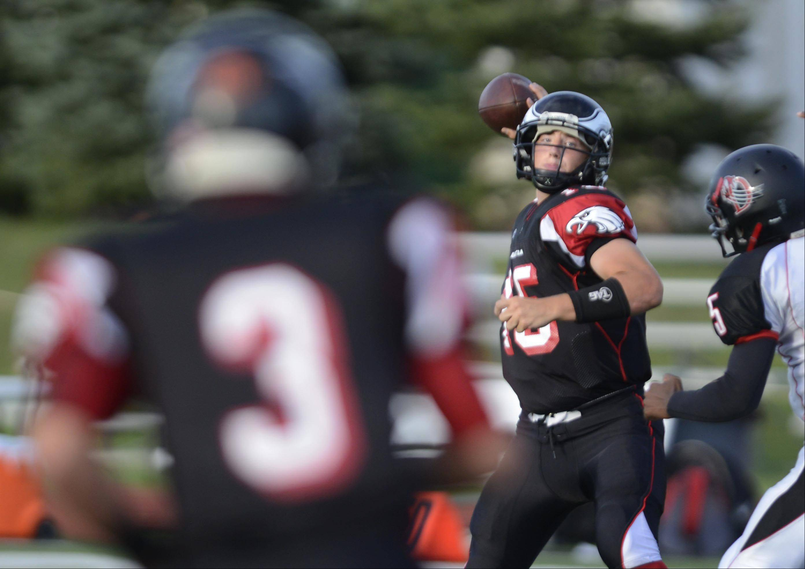 Aurora Christian quarterback Austin Bray throws to wide receiver Brandon Walgren for a first-half touchdown against DuSable in a rare Tuesday game in Aurora. Aurora Christian scored 57 first half points.