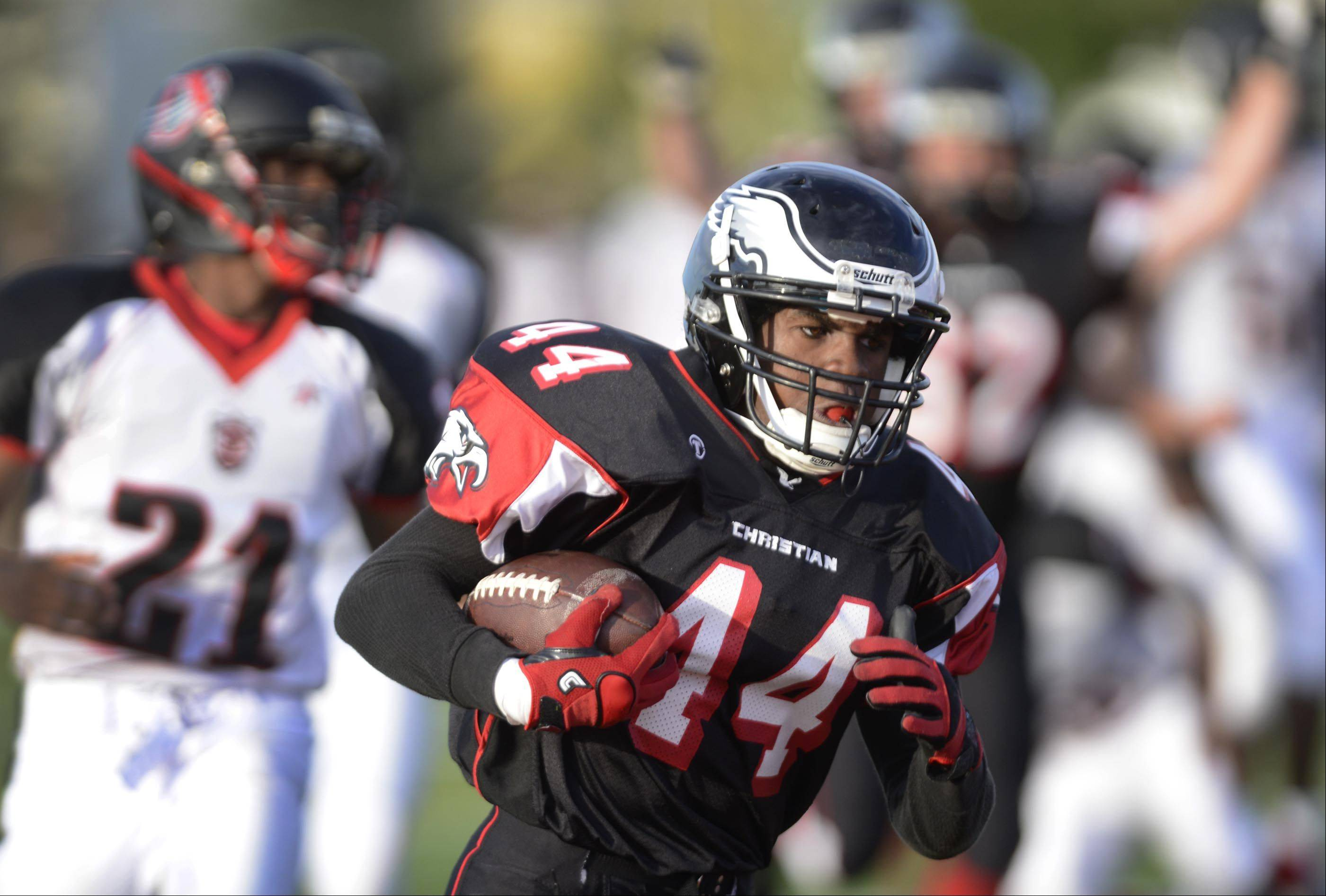 Aurora Christian's Legend Smith scores one of his first half touchdowns against DuSable in a rare Tuesday game in Aurora.