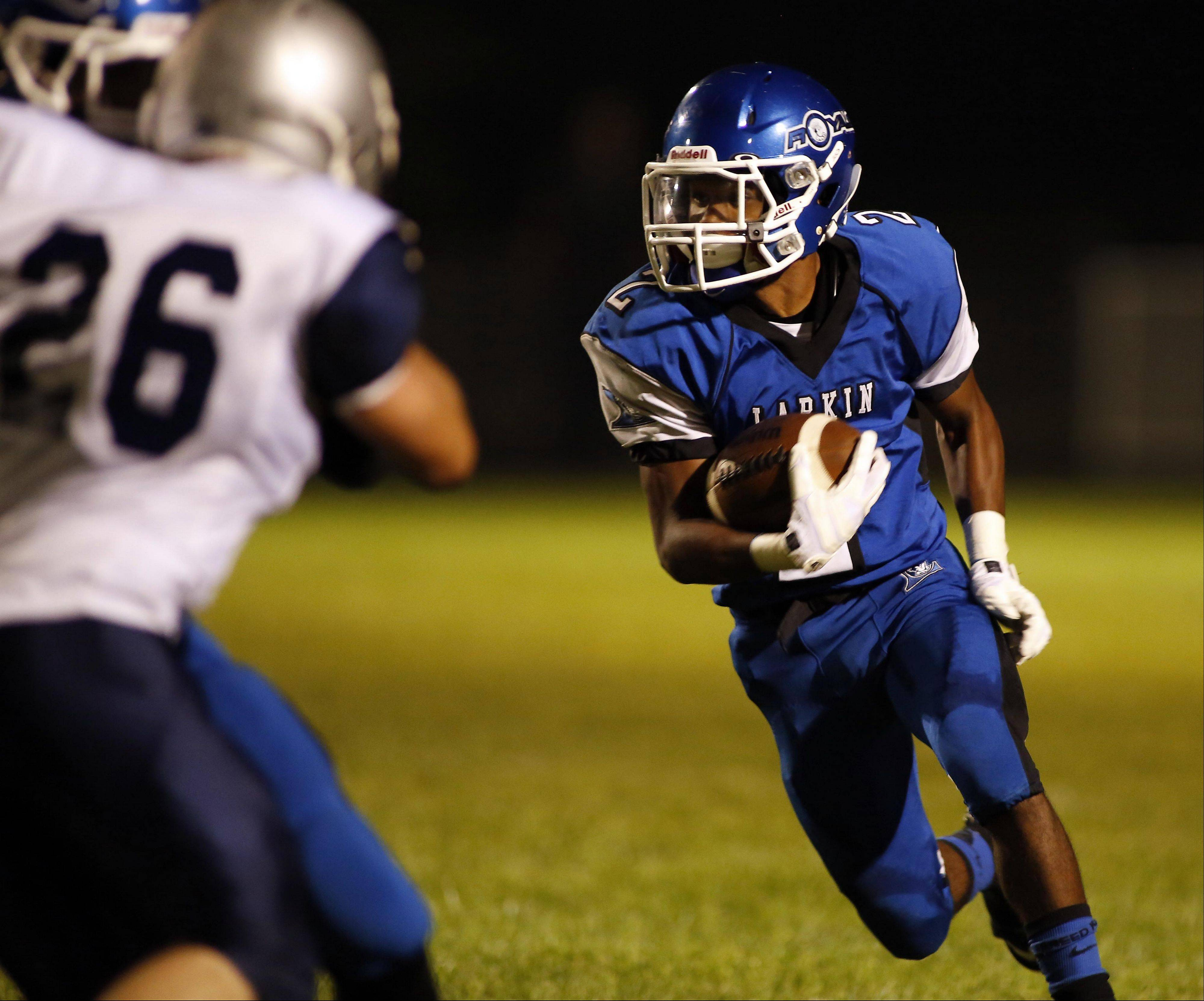 Larkin's Damion Clemons looks to gain yardage Friday night against West Chicago at Memorial Field. Clemons' 2-yard run in overtime lifted the Royals to a 20-12 win.