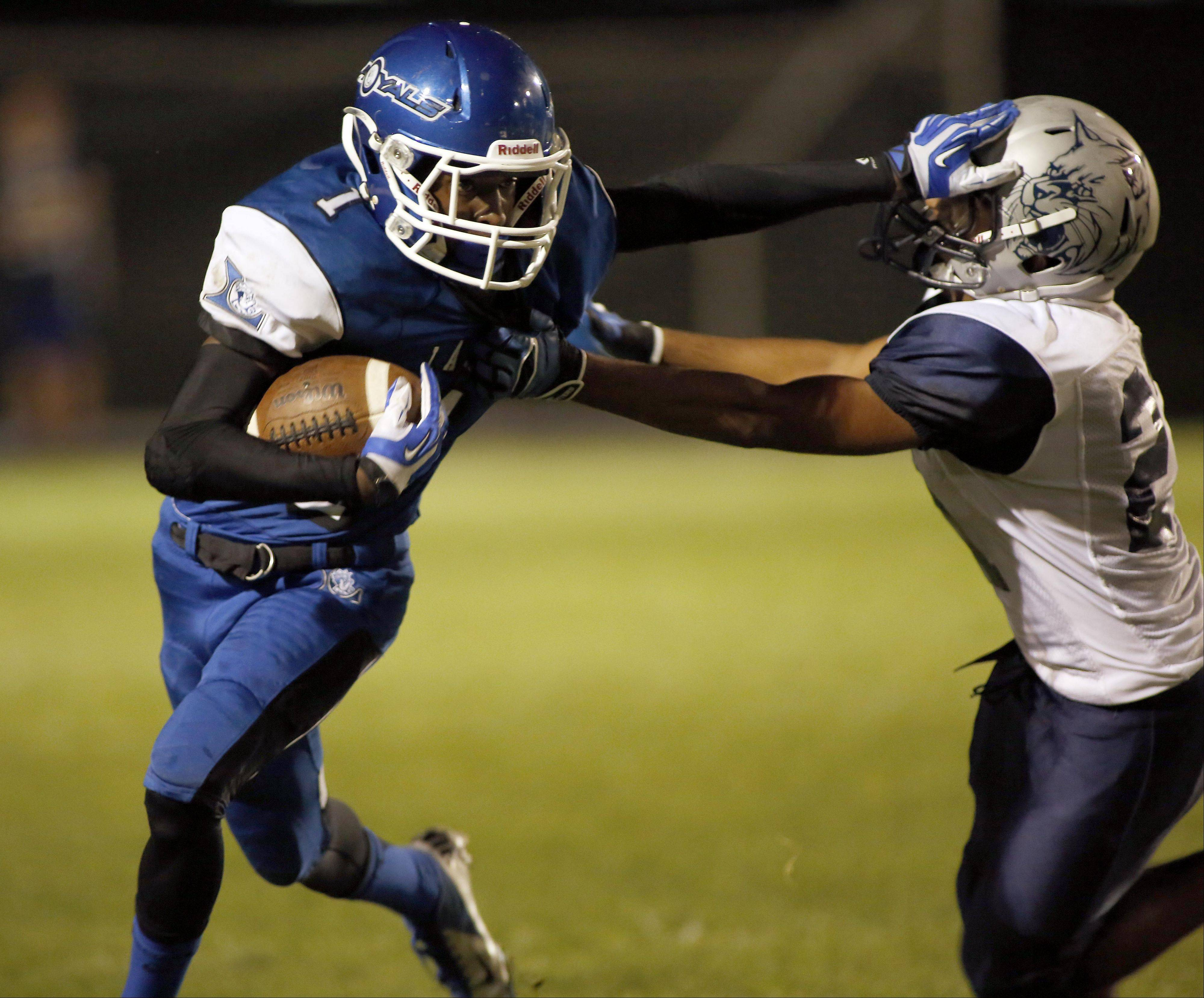 Larkin's Jarelle Shipp moves past a West Chicago player during action at Memorial Field in Elgin Friday night.