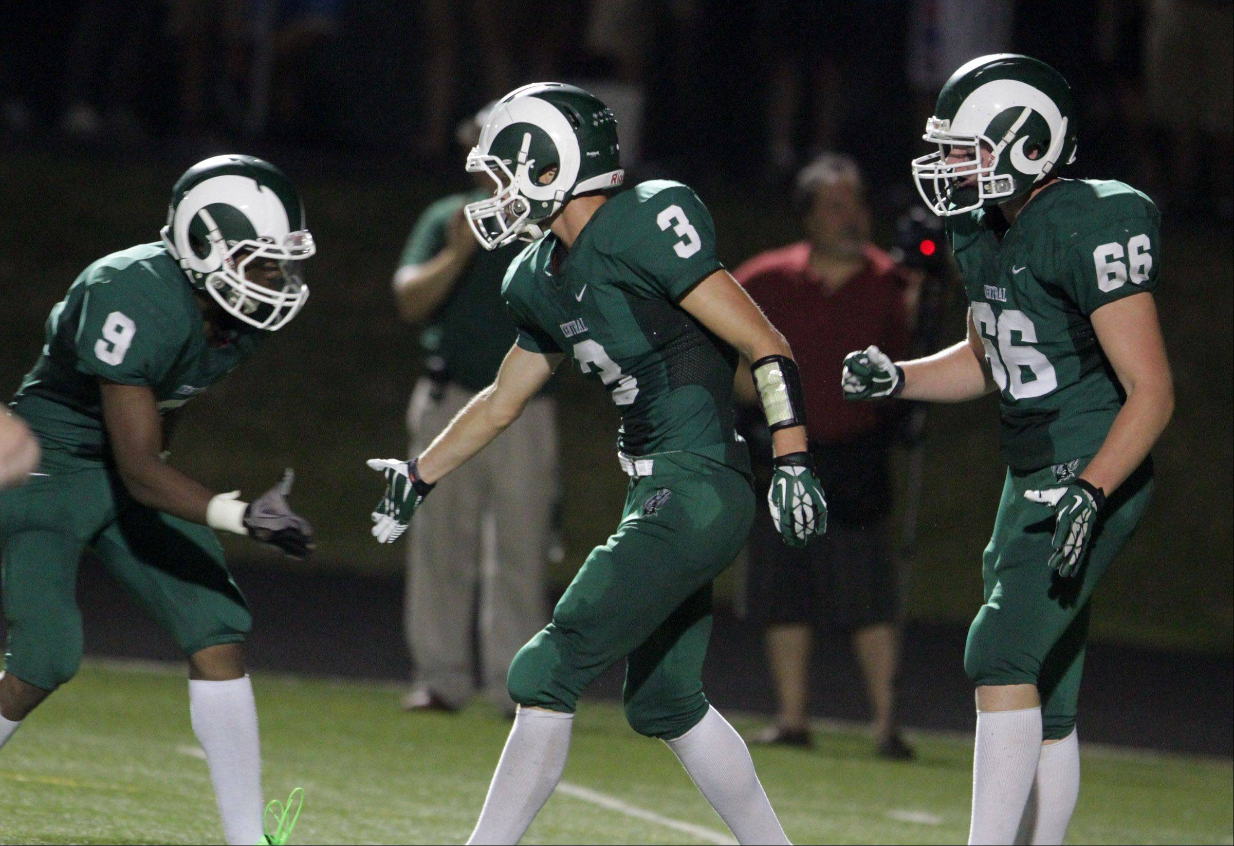 George LeClaire/gleclaire@dailyherald.comGrayslake Central wide-receiver Jacob Vargo gets a hand from Maurice Merrell, left, and Eamon Peterson after scoring a touch down in the first half against Vernon Hills at Grayslake Central on Friday, September 6, 2013.