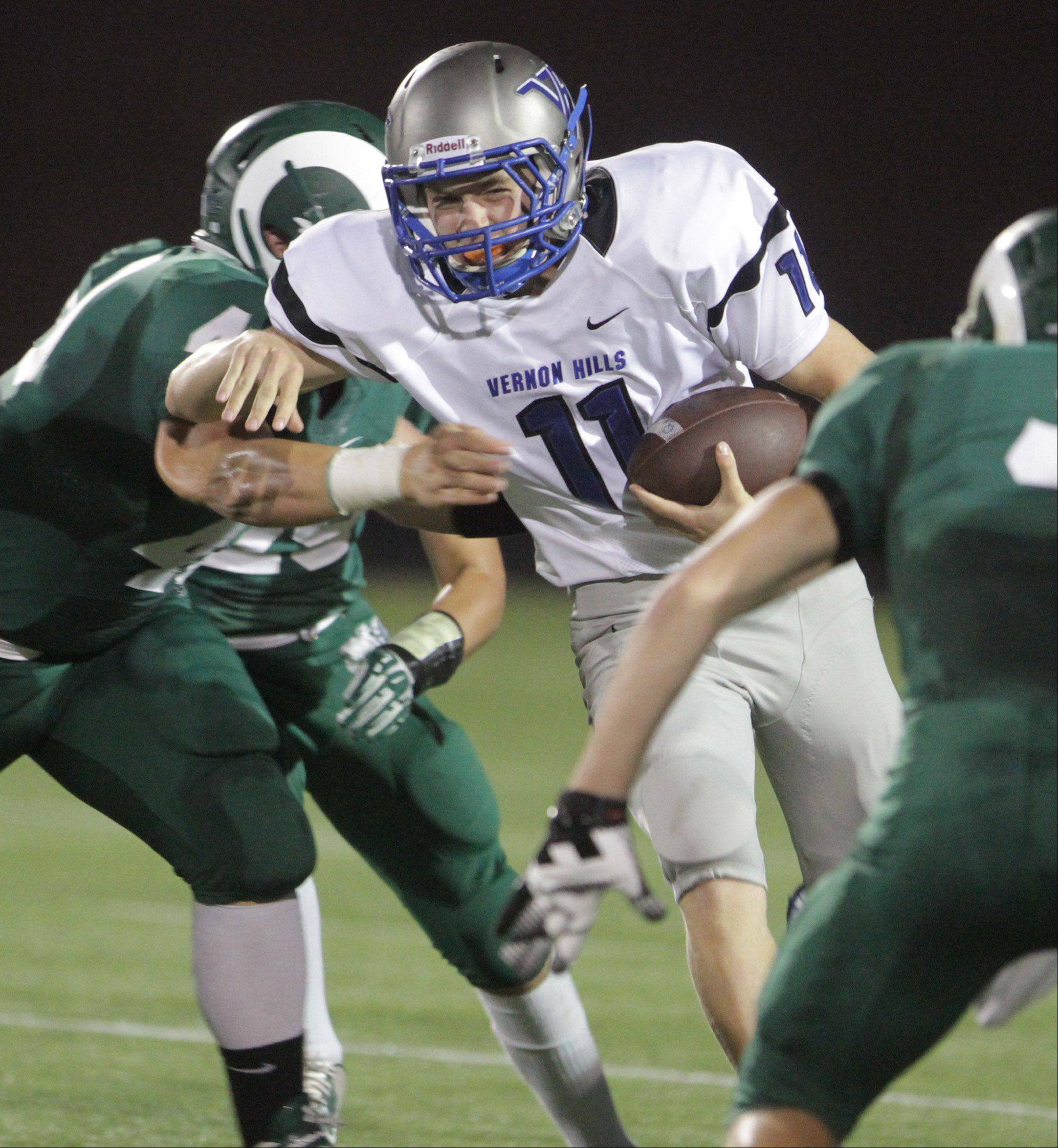 George LeClaire/gleclaire@dailyherald.com Vernon Hills' quarterback Connor McNamara runs the ball against Grayslake Central at Grayslake Central on Friday, September 6, 2013.