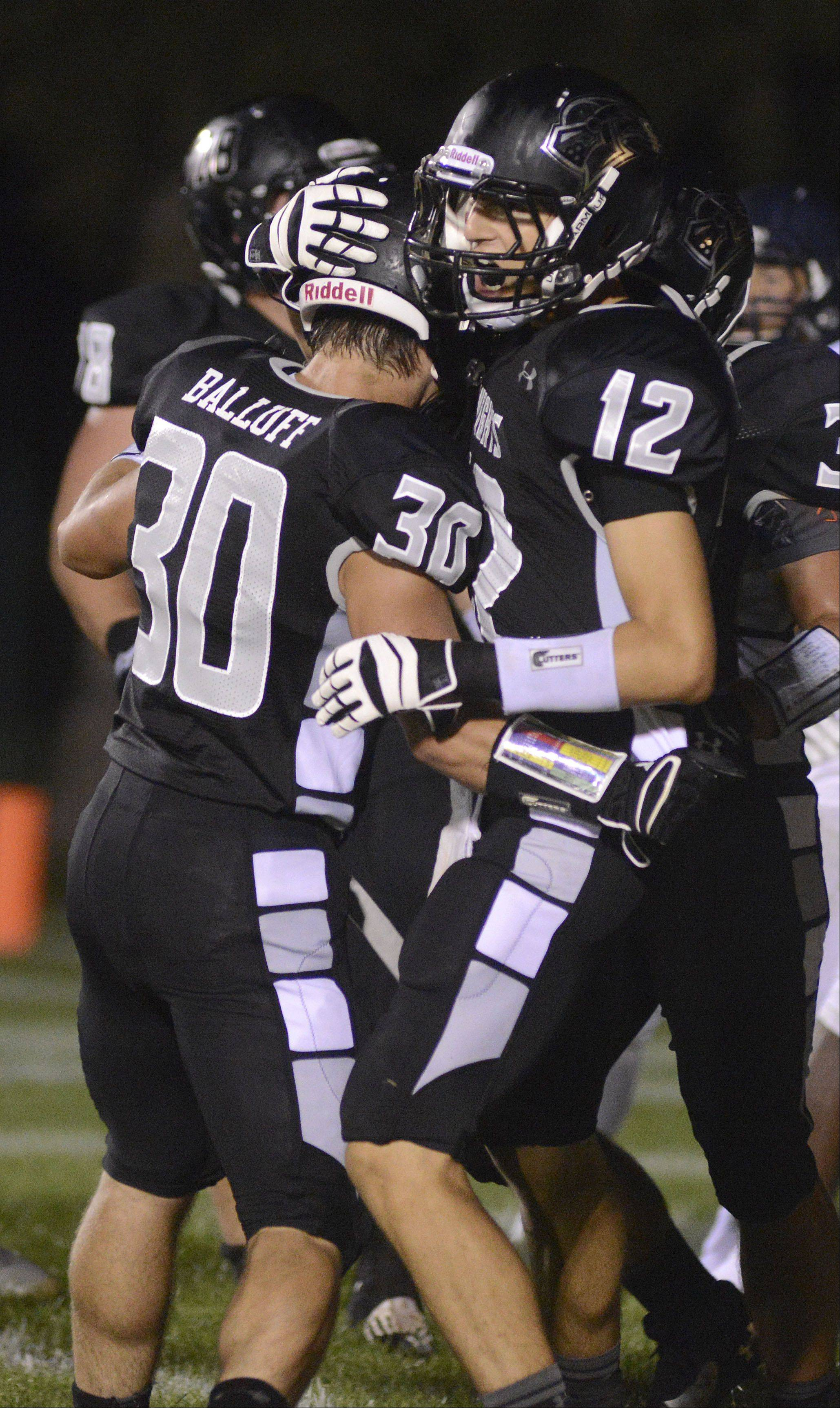 Kaneland's Jesse Balluff is congratulated on another touchdown by teammate Kevin Fuchs in the second quarter on Friday, September 6.