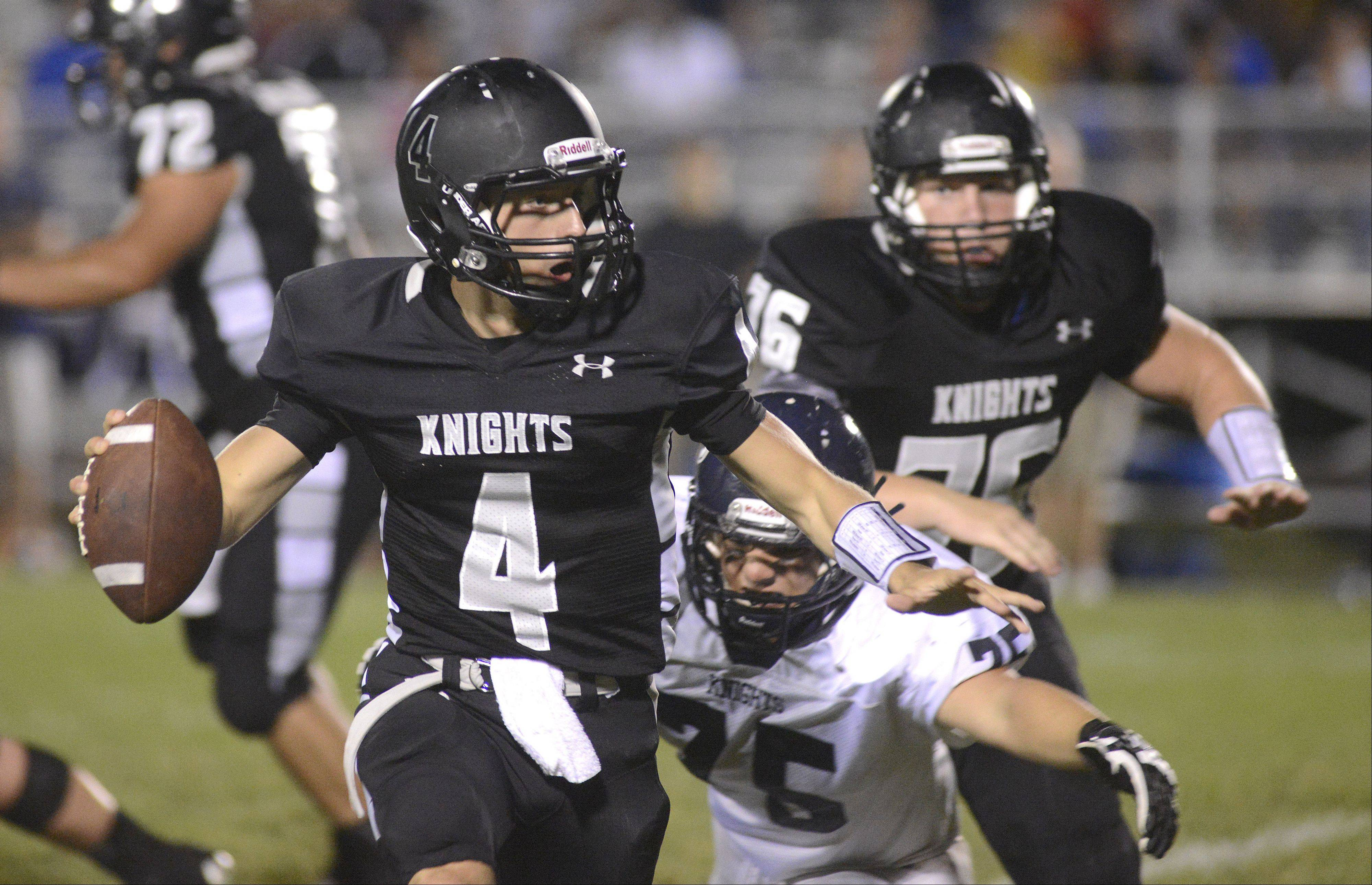 Kaneland quarterback Drew David looks to pass the ball before being sacked by IC Catholic Prep's Sam Lytton in the second quarter on Friday, September 6.