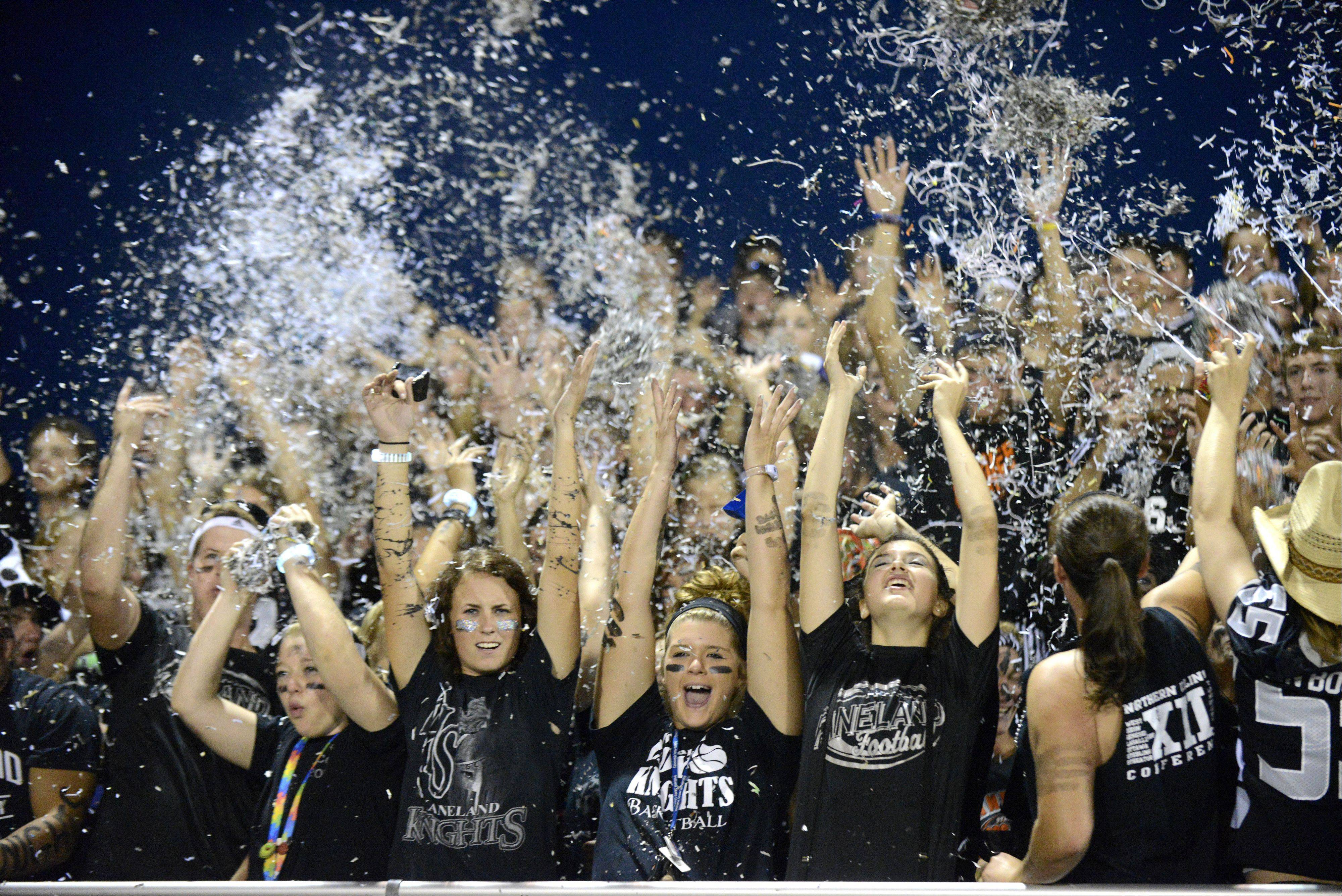 Allison Miller, 17, of Sugar Grove, Brittany Kemp, 17, of Elburn and Brin Will, 17, of Sugar Grove celebrate in the front row of the student section.