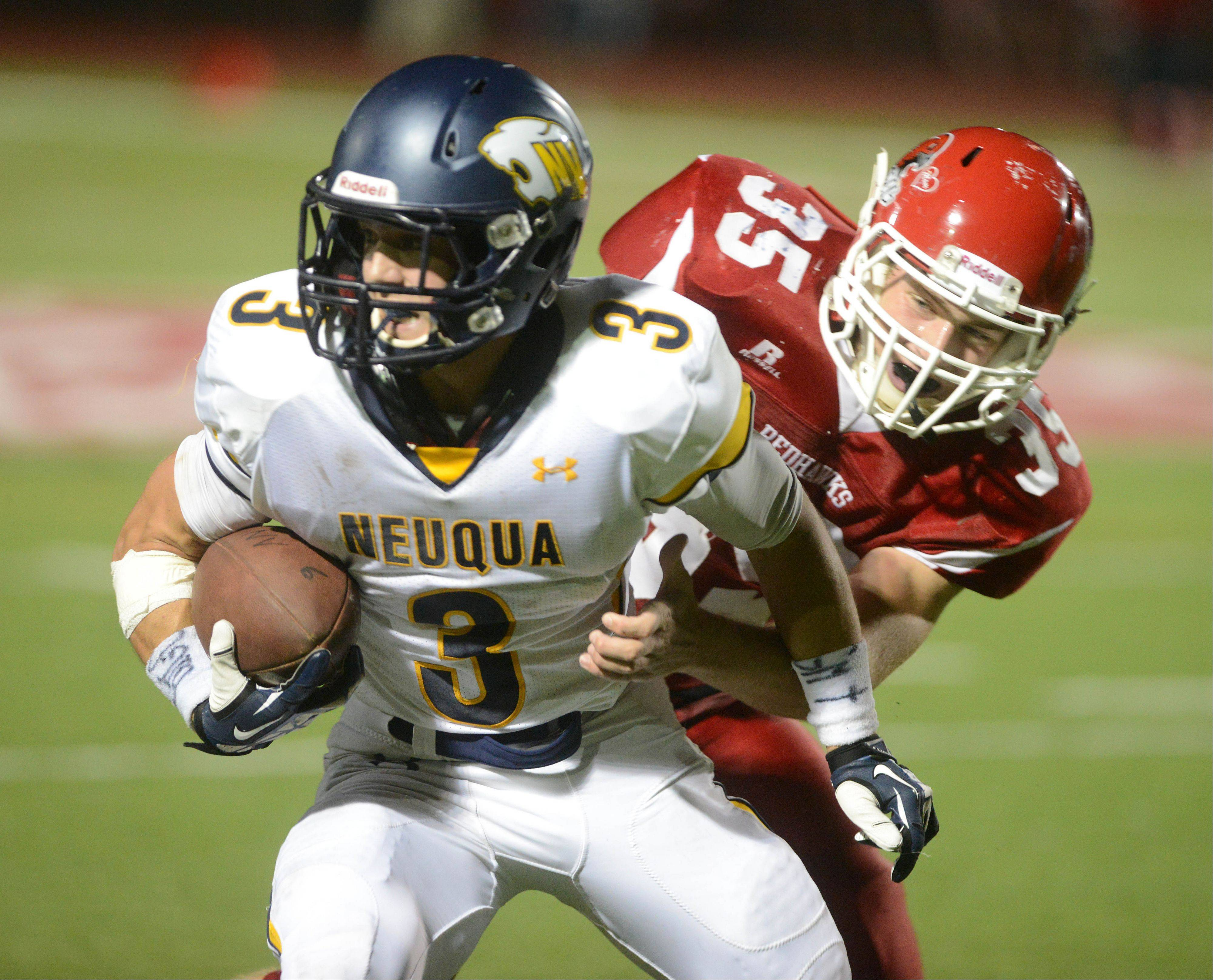 Mikey Dudek,left, of Neuqua Valley is pulled down by Dan Delgrosso of Naperville Central.