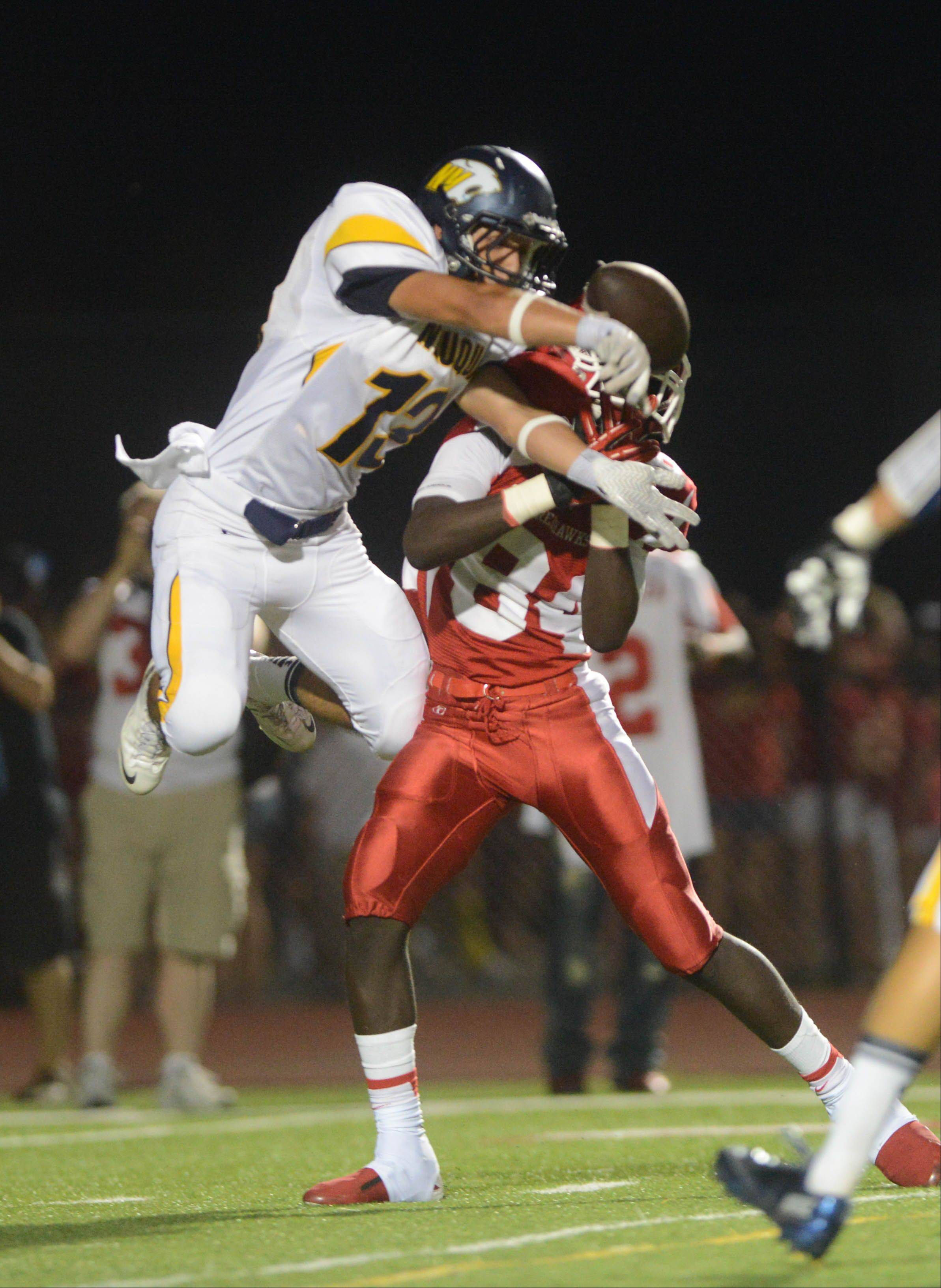 Sheldon Jones of Neuqua Valley and Emmanuel Rugamba of Naperville central go up for a pass.
