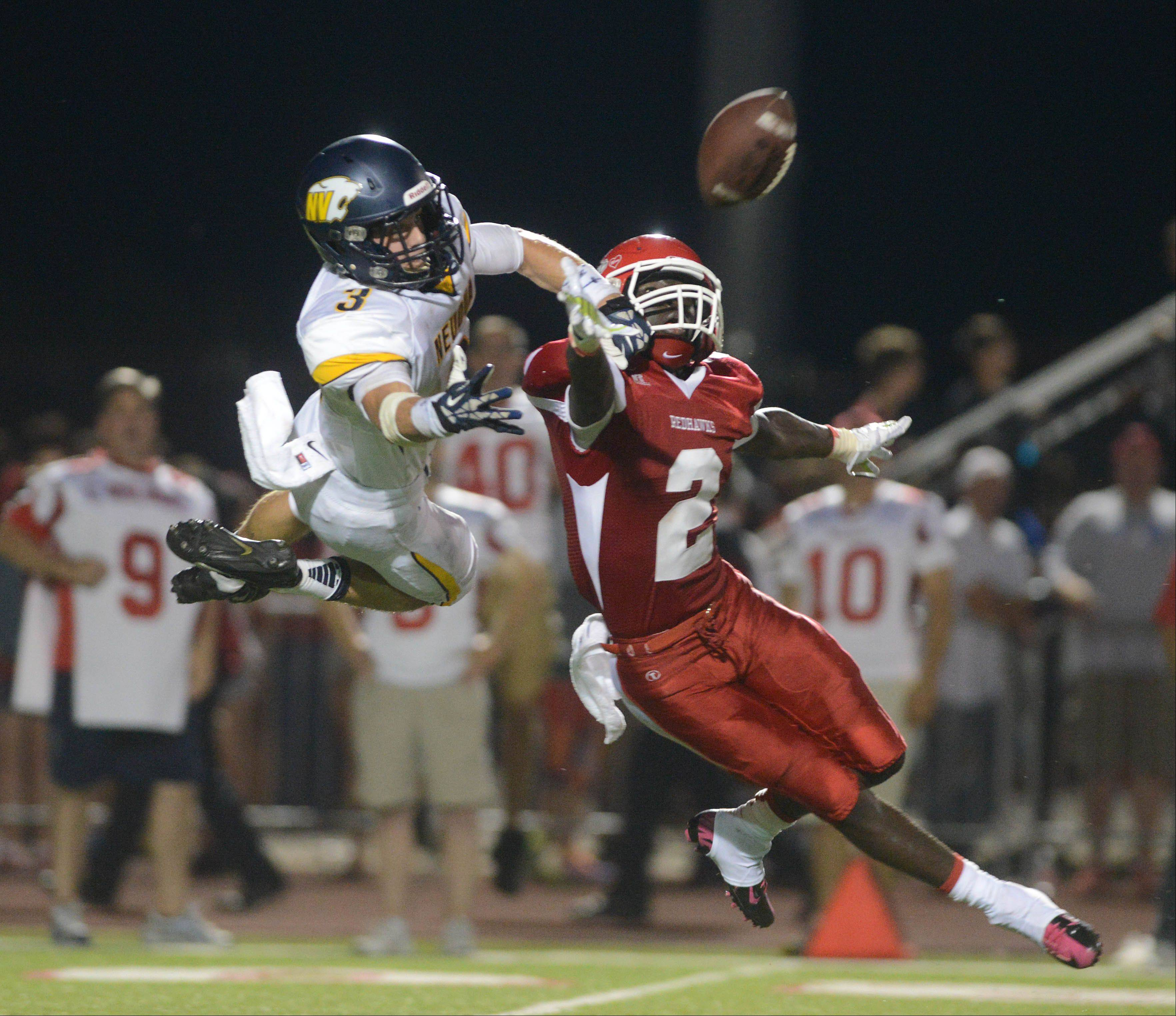 Mikey Dudek of Neuqua Valley,left, and Jon Lubanza of Naperville Central go up for pass.