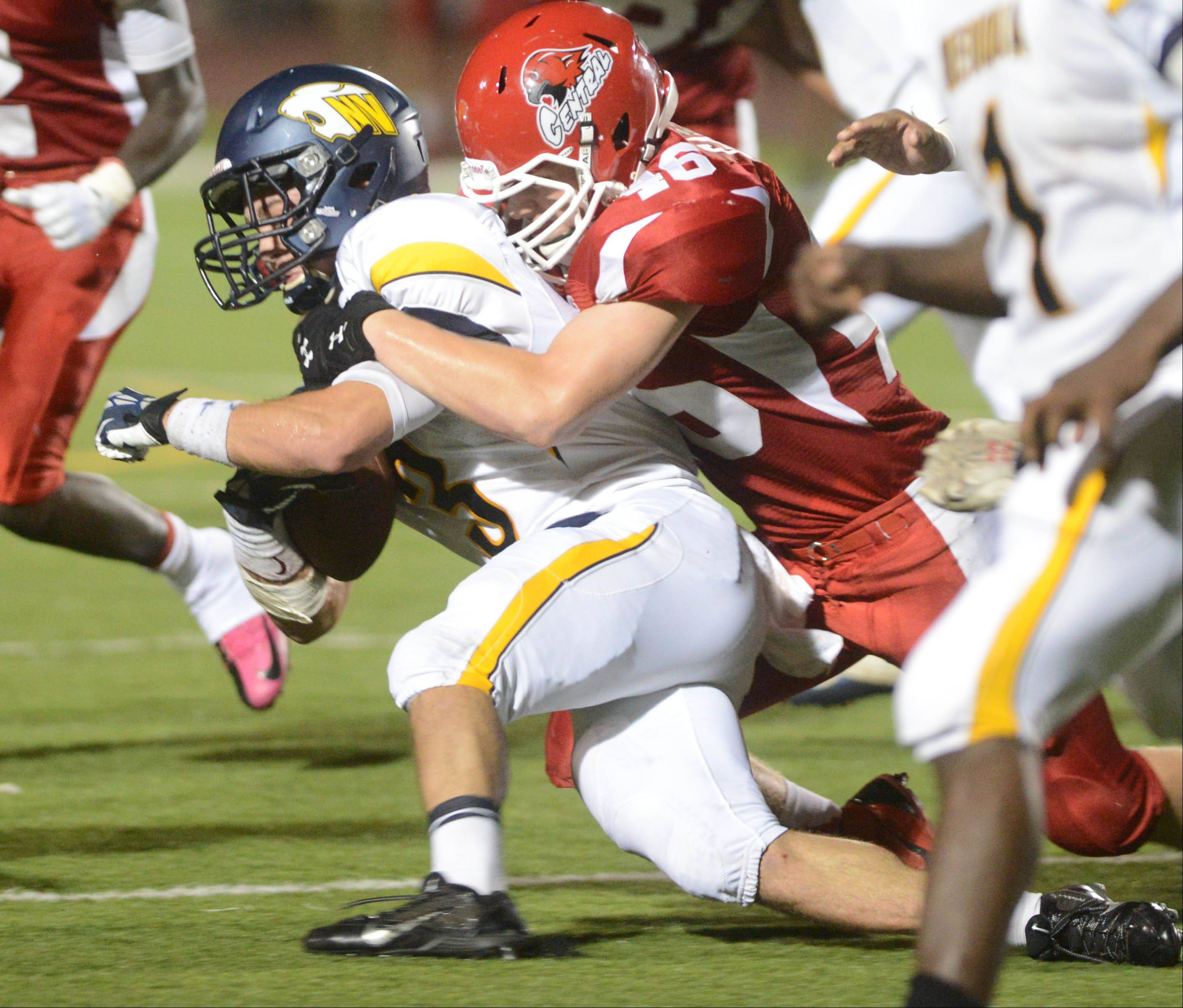 Mikey Dudek,left, of Neuqua Valley is pulled down by Billy Gammon of Naperville Central.