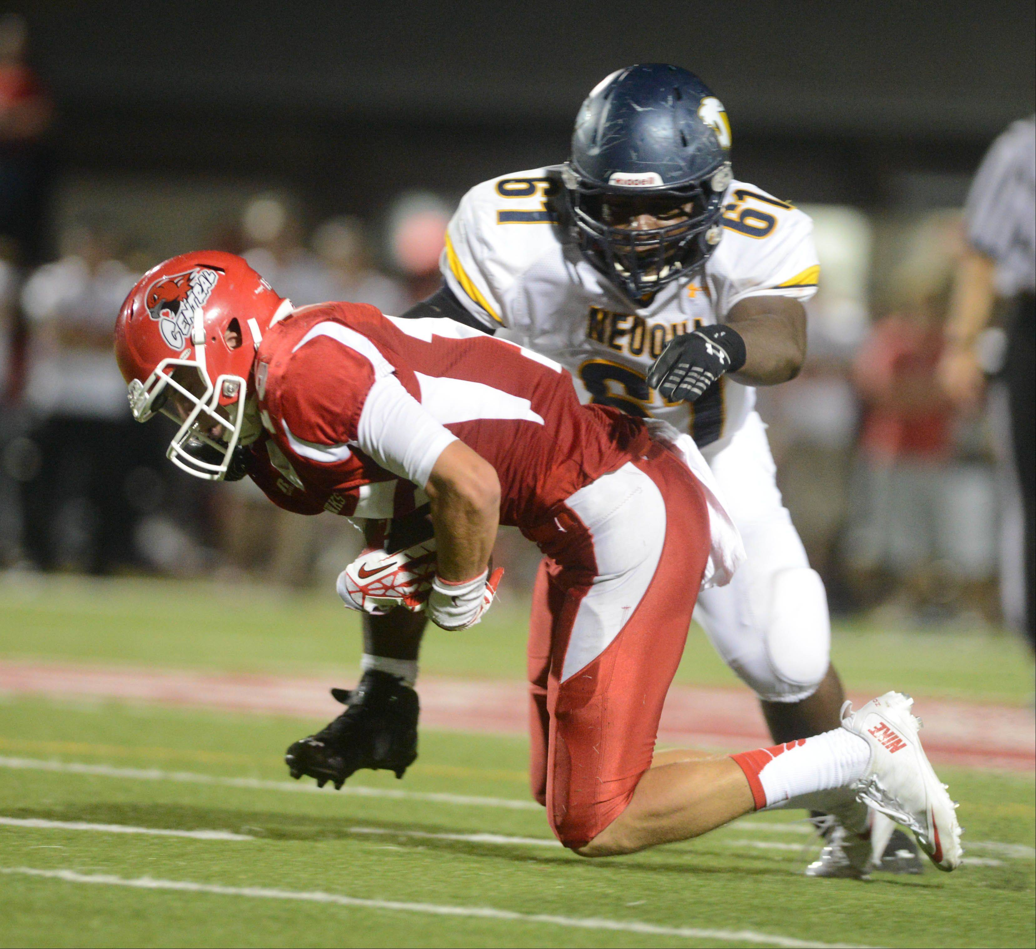 Michael Kolzow of Naperville central,left, is pulled down by Godfrey Collins of Neuqua Valley.