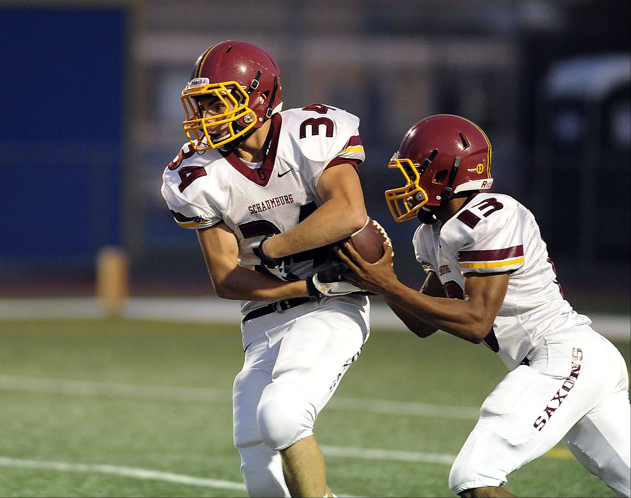 Schaumburg's quarterback Stacey Smith Jr. fakes a handoff to Michael Jones and runs back for a touchdown.