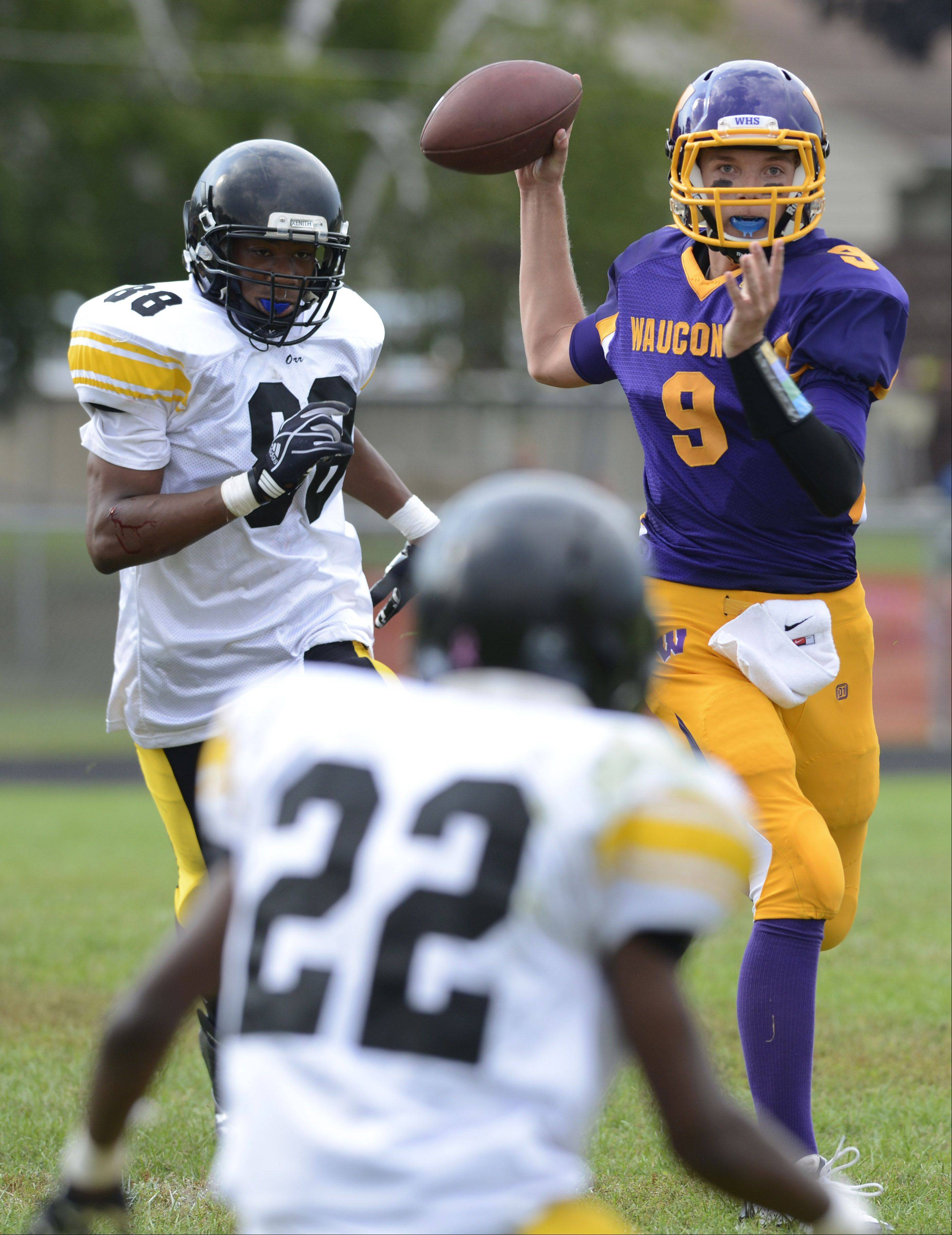 Wauconda quarterback Kevin Malisheski throws a pass during Saturday's game against Orr.