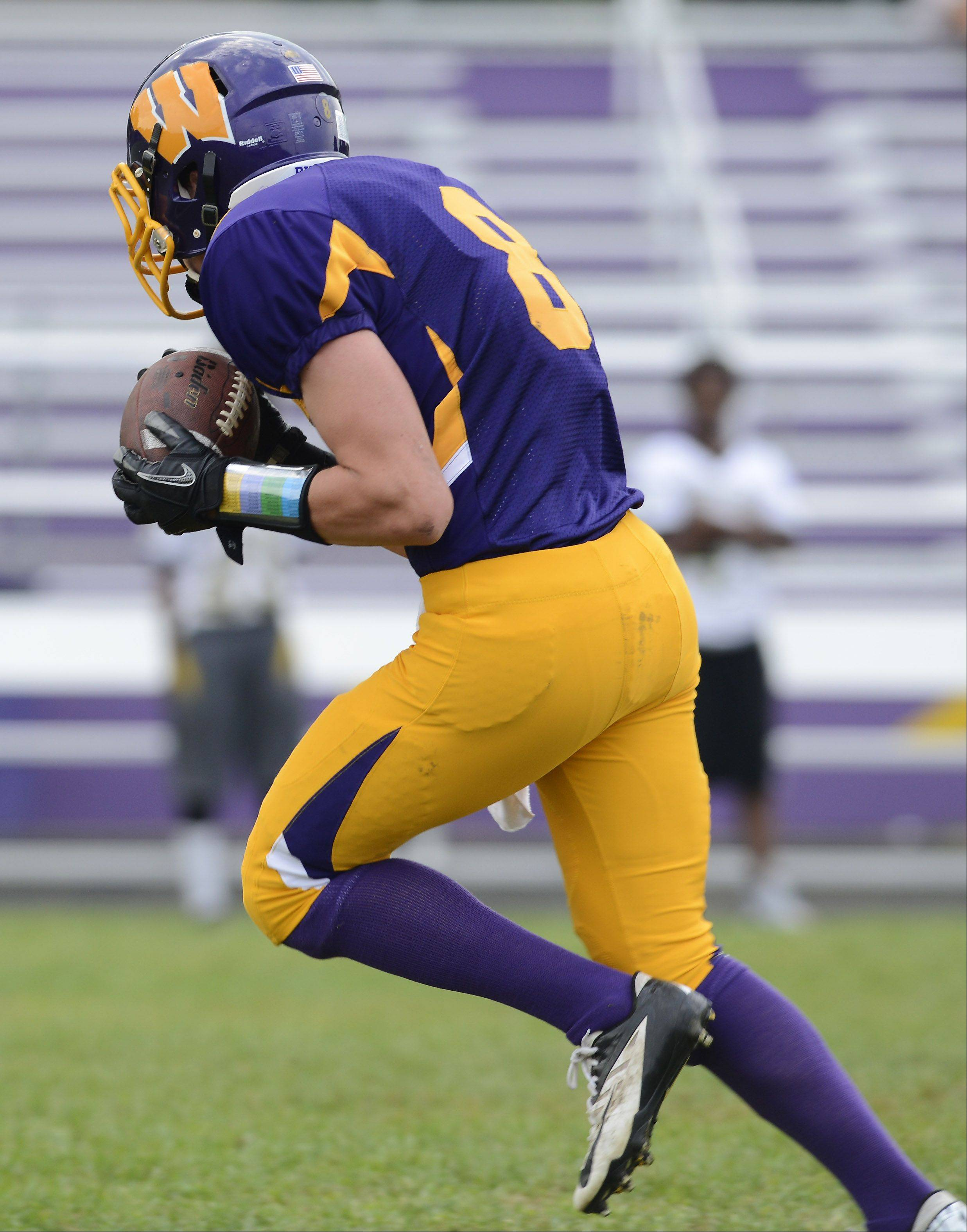 Wauconda's Alex Schwickrath makes a first-quarter reception that went for a touchdown during Saturday's game against Orr.