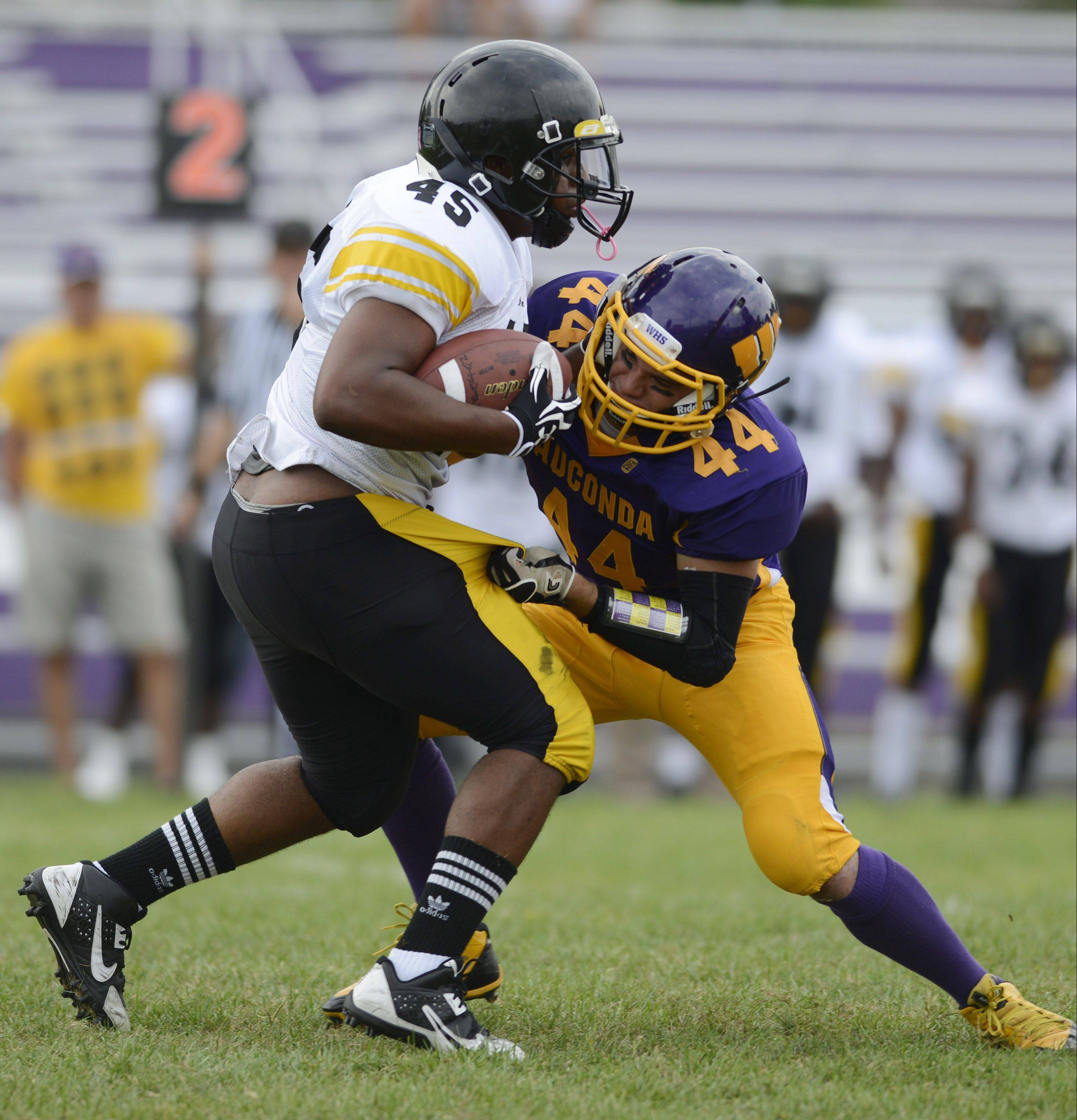 Wauconda's Michael Prate, right, tackles Orr's Daniel Sanja