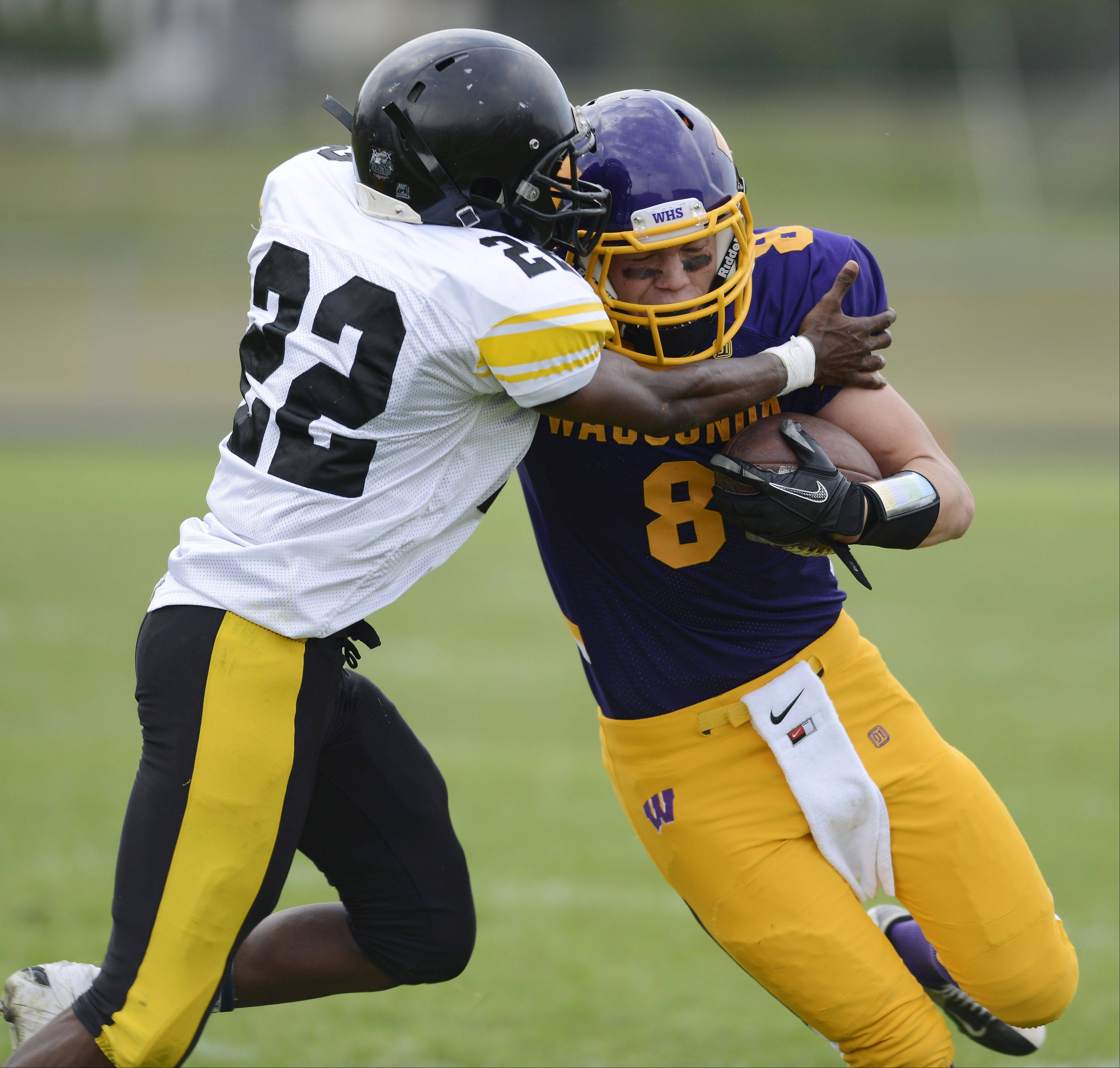 Wauconda's Alex Schwickrath, right, tries to pick up additional yardage as he is met by Orr's Lamont Stanton during Saturday's game.