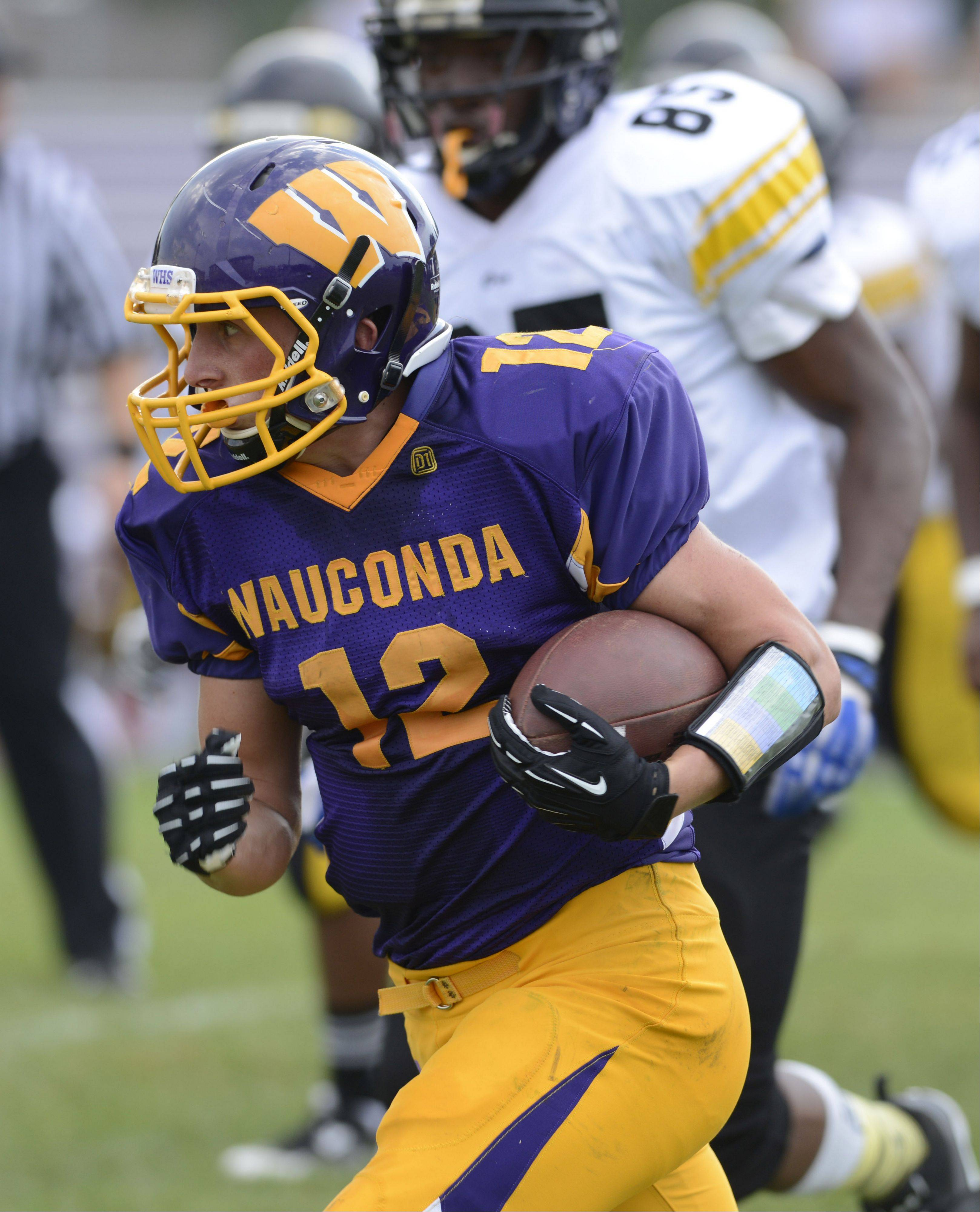 Wauconda's Alex Payne carries the ball during Saturday's game against Orr.