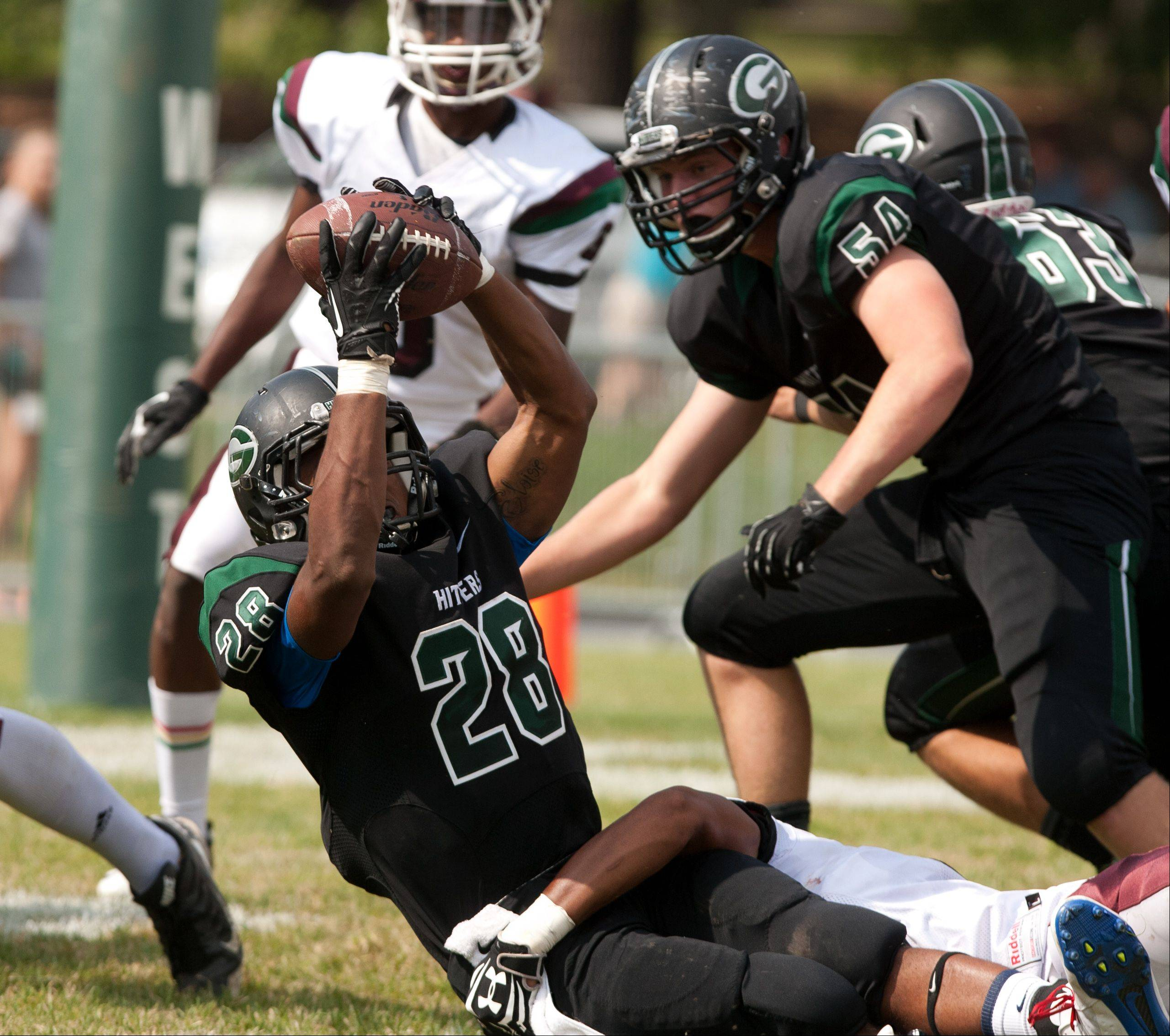 Glenbard West's Jermon Kindle Joyner extends to score a first half touchdown against Morton.