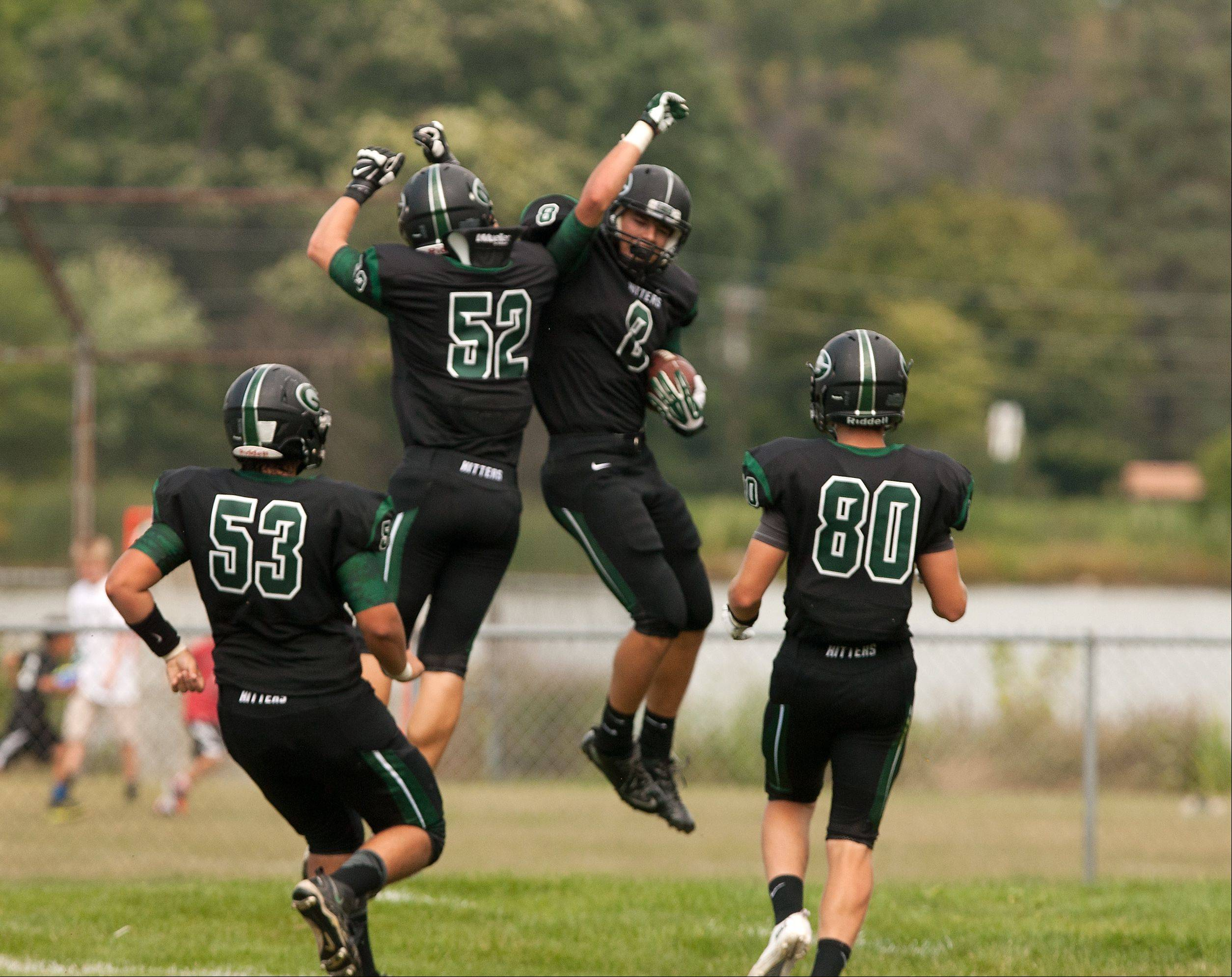 Glenbard West's Hayden Carlson celebrates after scoring a first half touchdown against Morton.