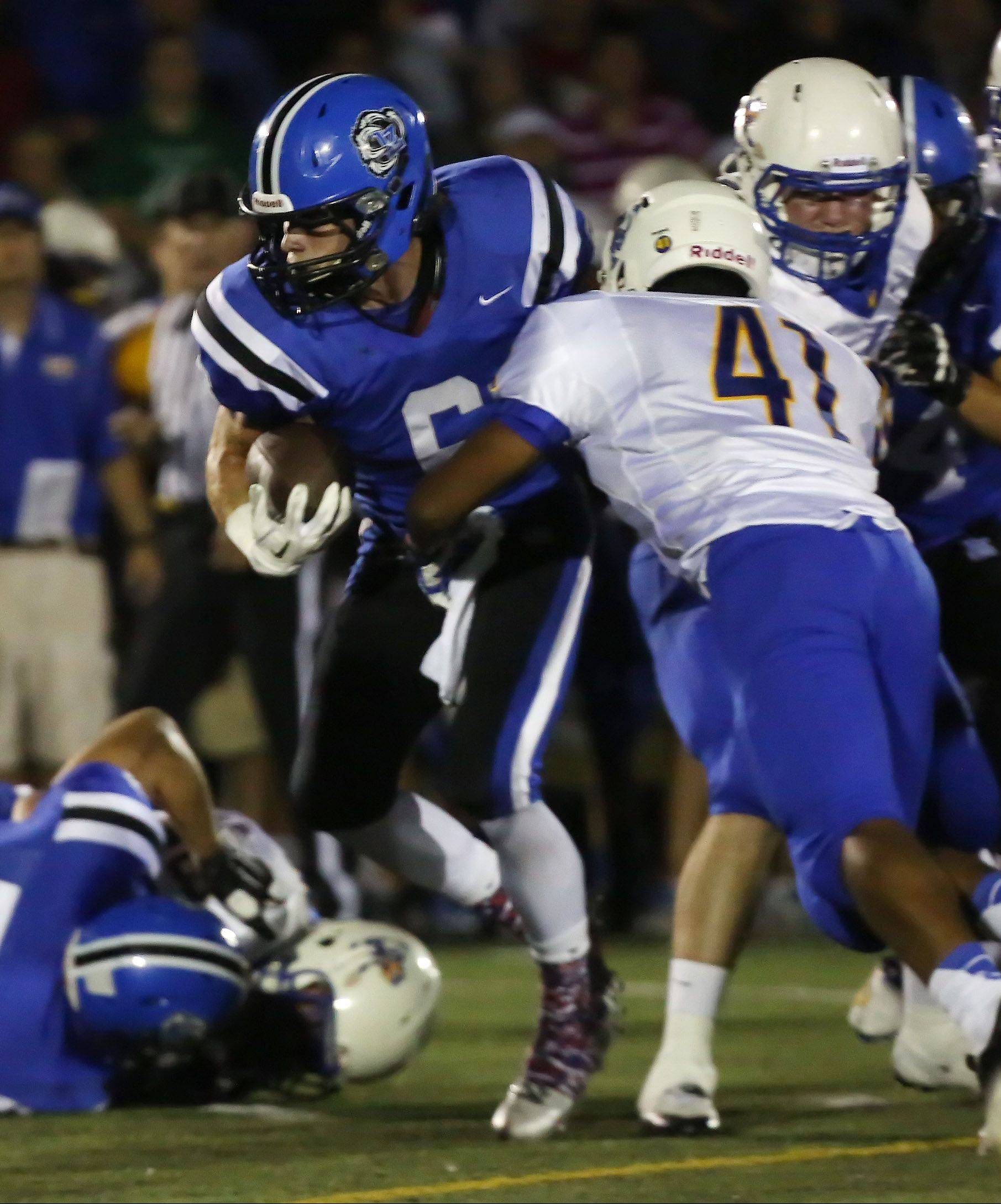 Lake Zurich running back Sean Lynch breaks an attempted tackle by Warren linebacker Zhane Garcia on the way to a first-quarter touchdown Thursday at Lake Zurich.