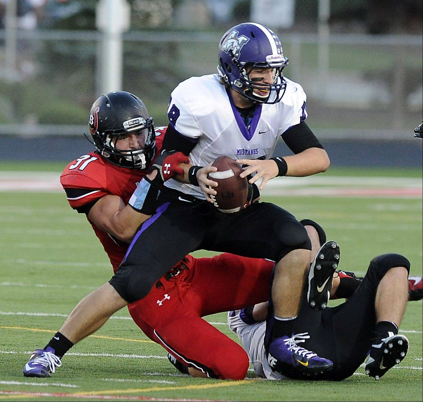Barrington's Colin Castagna brings down Rolling Meadows quarterback Bobby Suchecki on Thursday at Barrington.