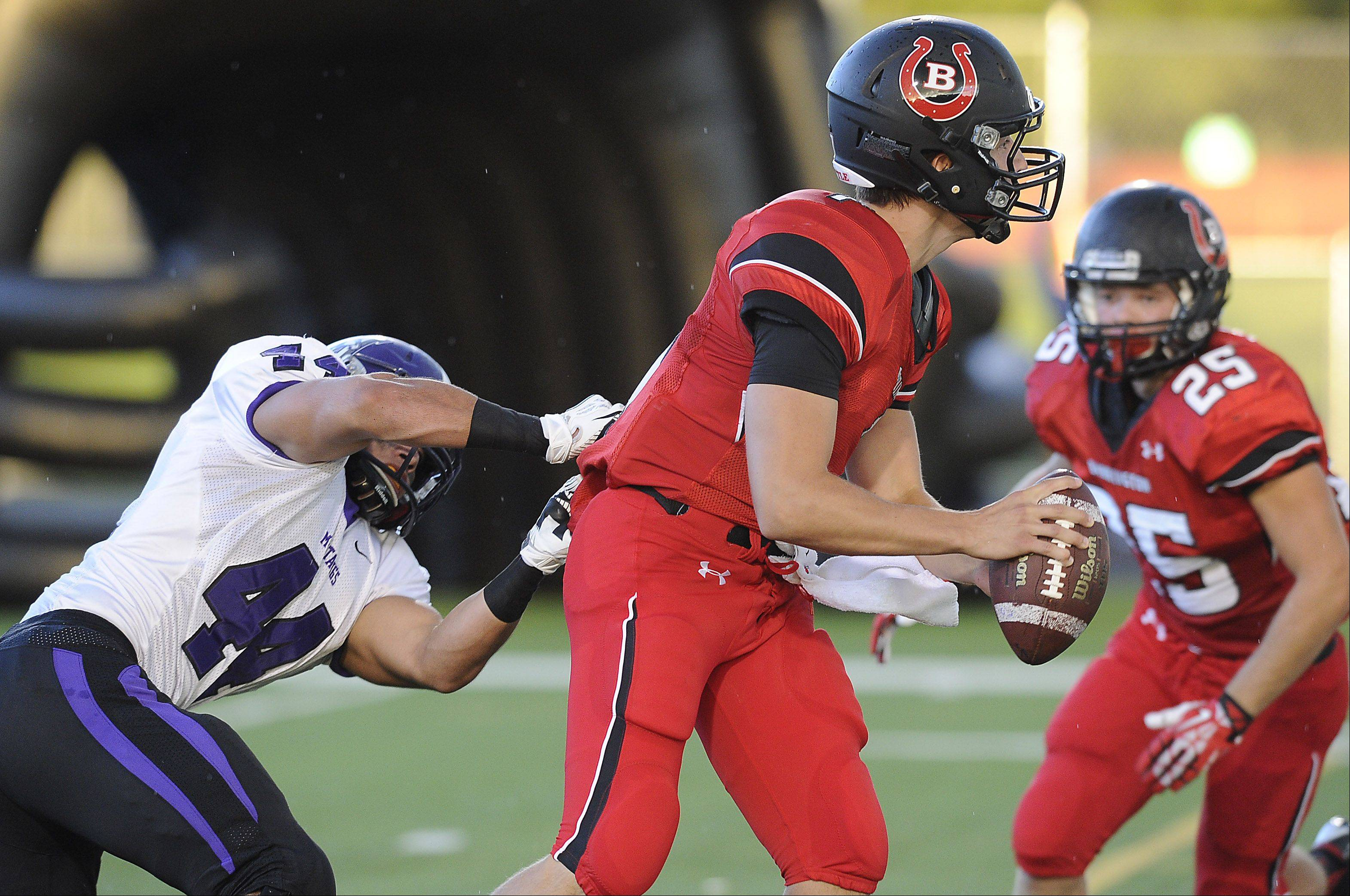 Rolling Meadows Eddie Cardenas sacks Barrington quarterback Daniel Kubiuk in the first quarter Thursday at Barrington.