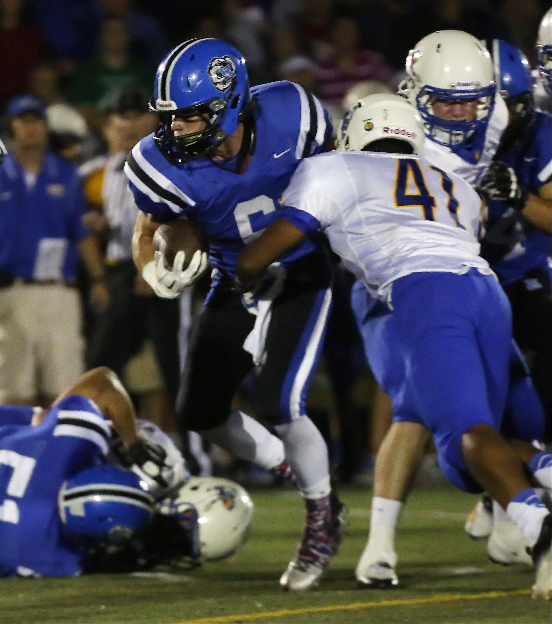 Lake Zurich running back Sean Lynch breaks the tackle of Warren linebacker Zhane Garcia on the way to a touchdown in the first quarter.