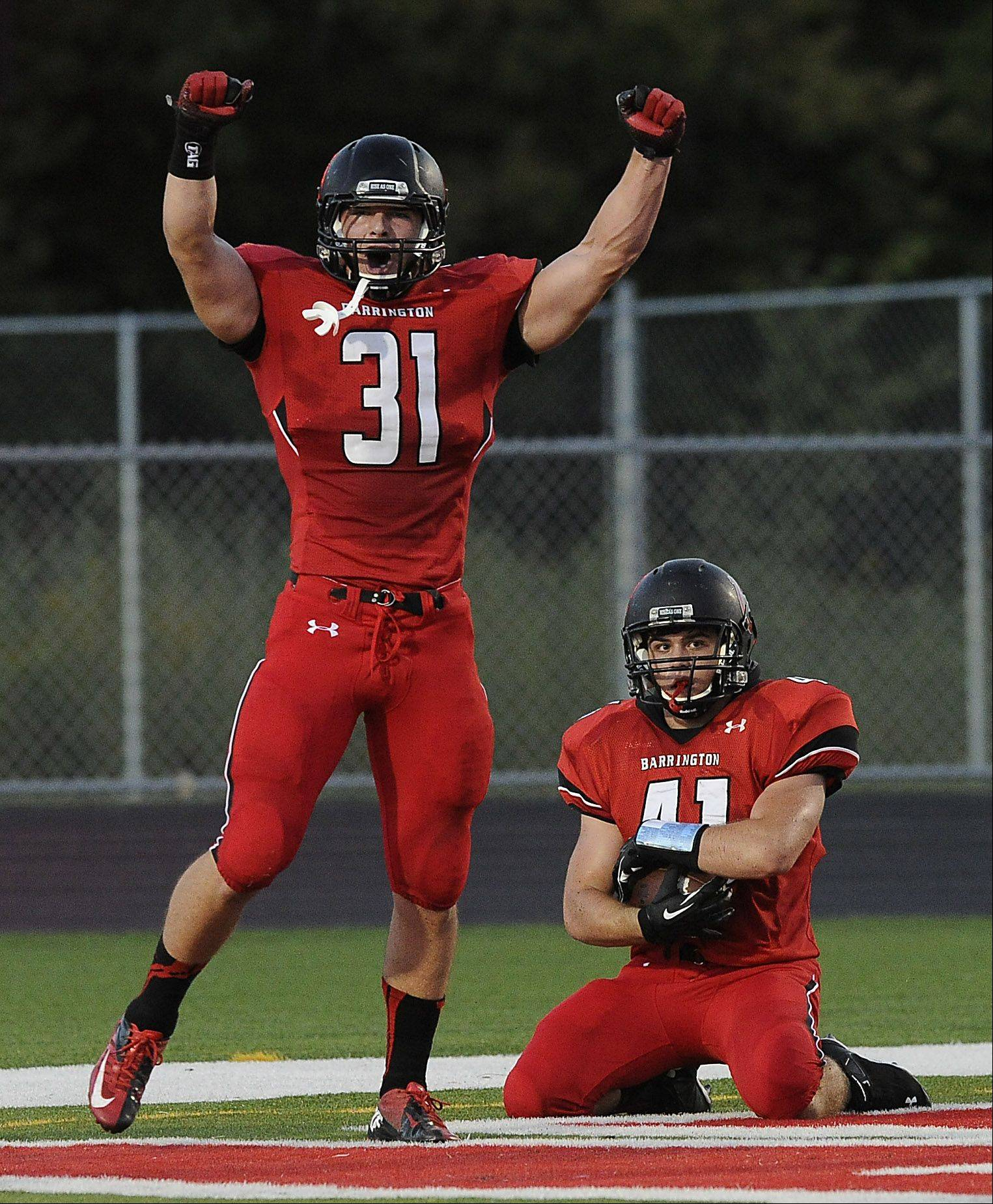 Barrington's Mark Bornhofen recovers a block punt for a touchdown as his teammate Yovani Romano celebrates.