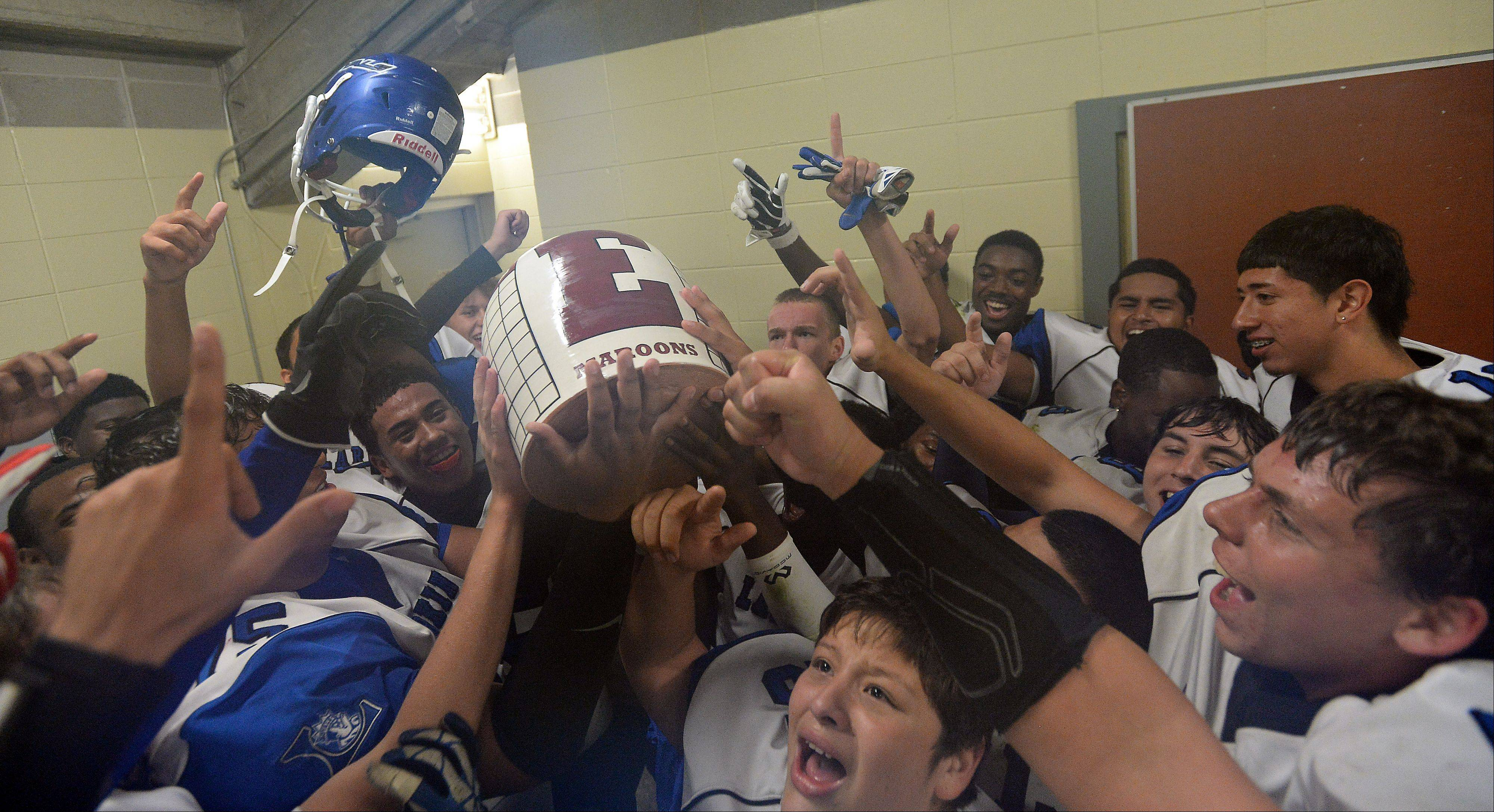 Larkin's locker room explodes with excitement after beating Elgin and claiming the Town Jug on Friday.