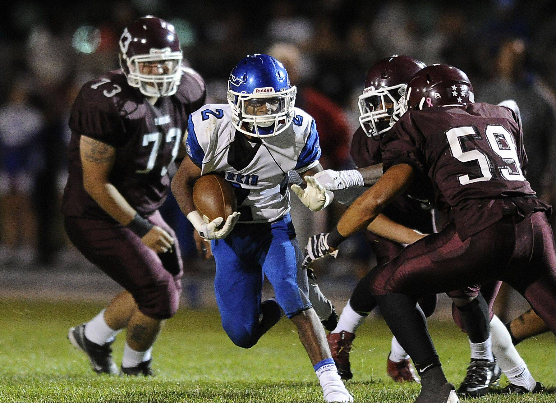 Larkin's Damion Clemons runs for short yardage in the first quarter at Elgin High School's Memorial Field on Friday.