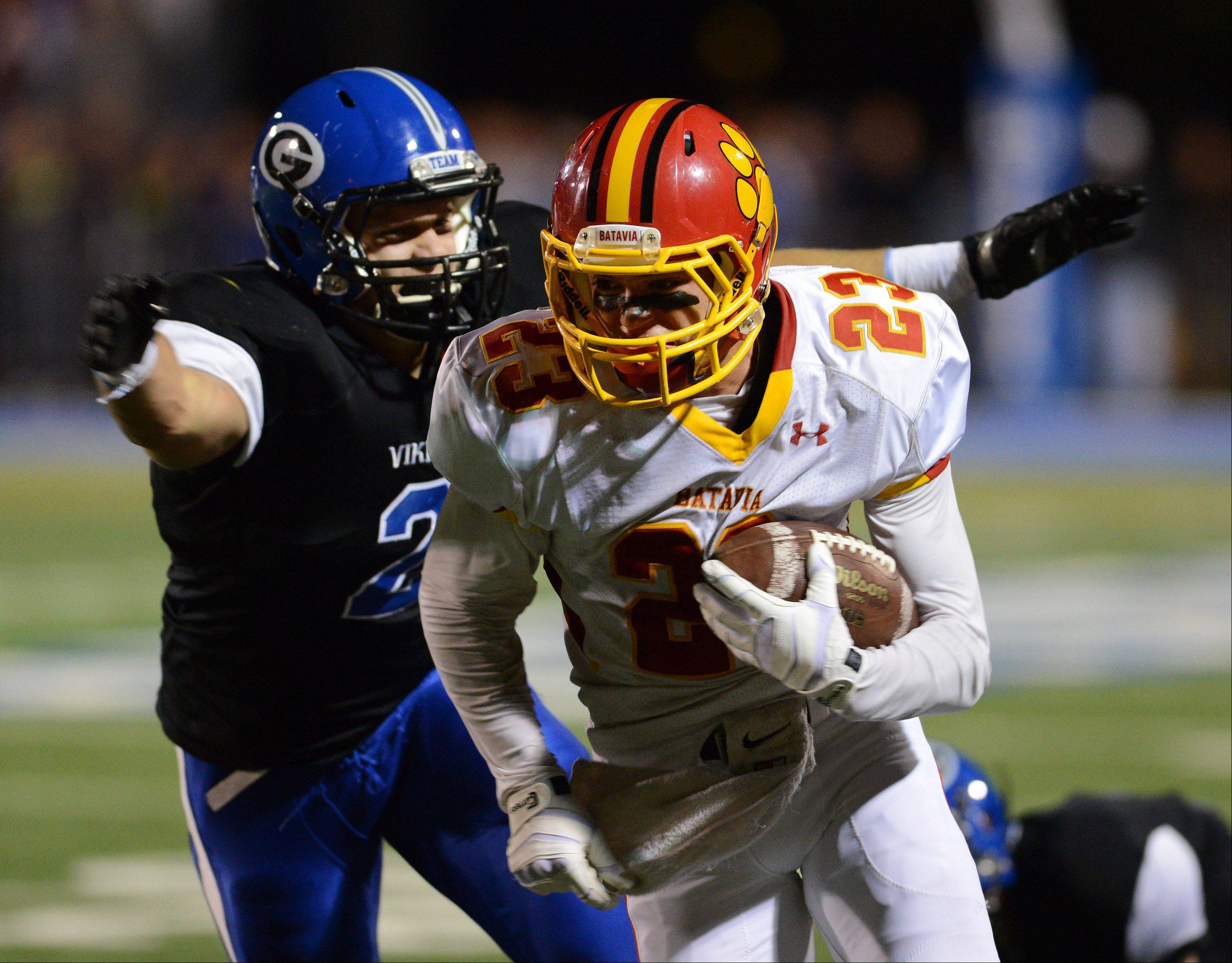 Geneva's Billy Douds closes in on Batavia's Michael Moffatt.