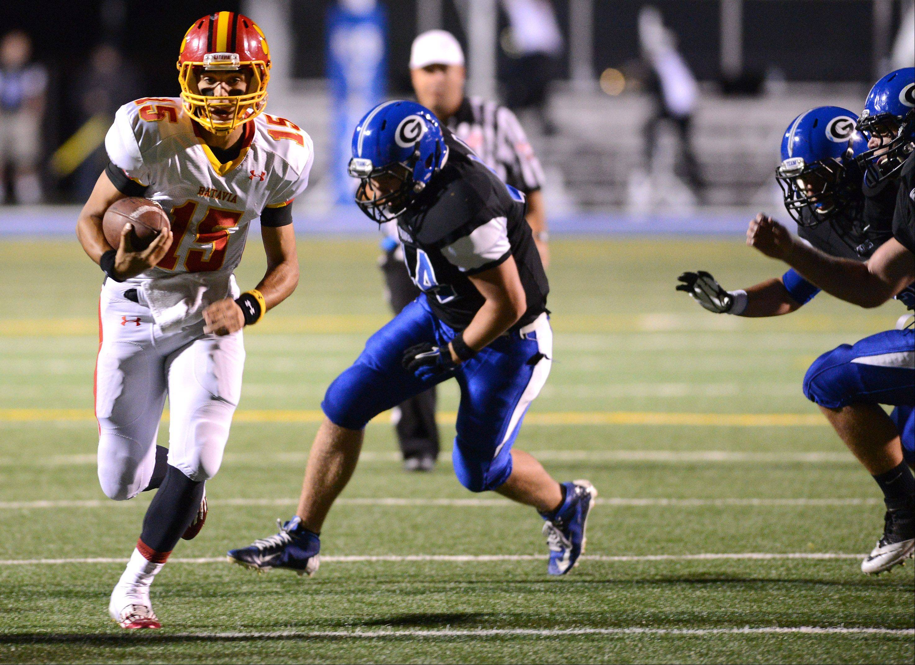 Batavia quarterback Micah Coffey leaves a trio of Geneva defenders in his wake en route to his third touchdown run of the first half.