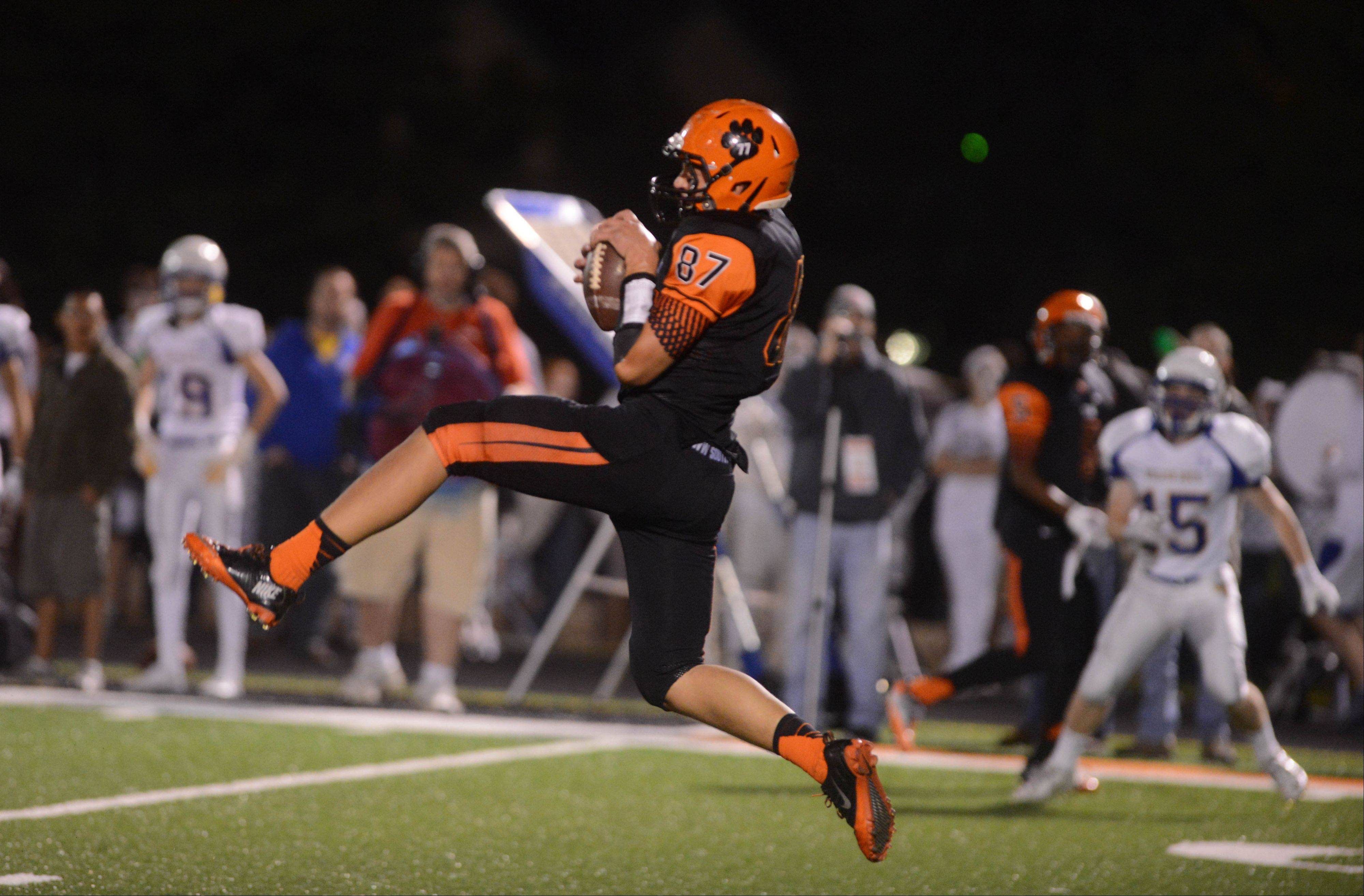 Connor Ostrander of Wheaton Warrenville South pulls down a pass.