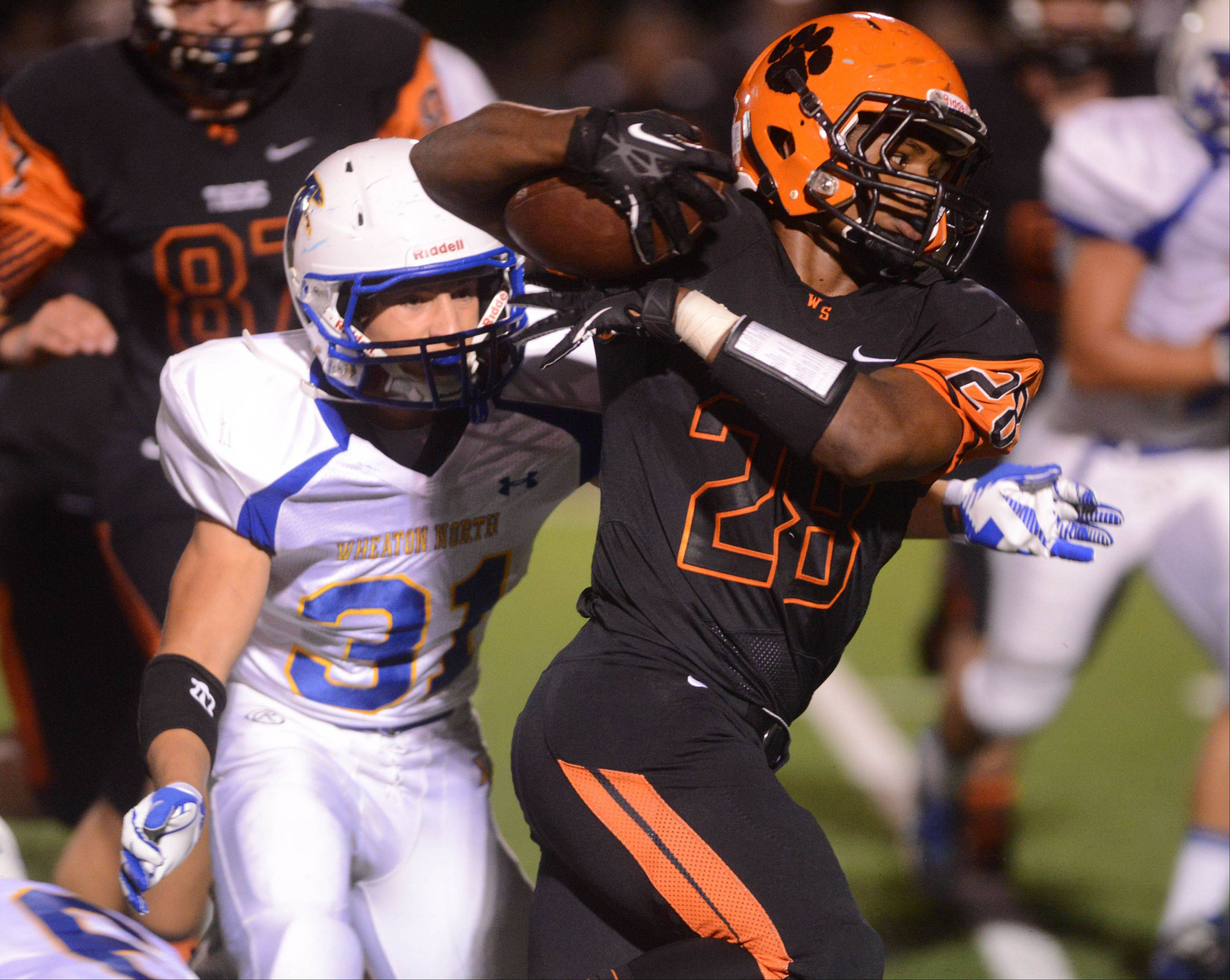 Nick Singleton of Wheaton North prepares to pull down Isaiah Campos.