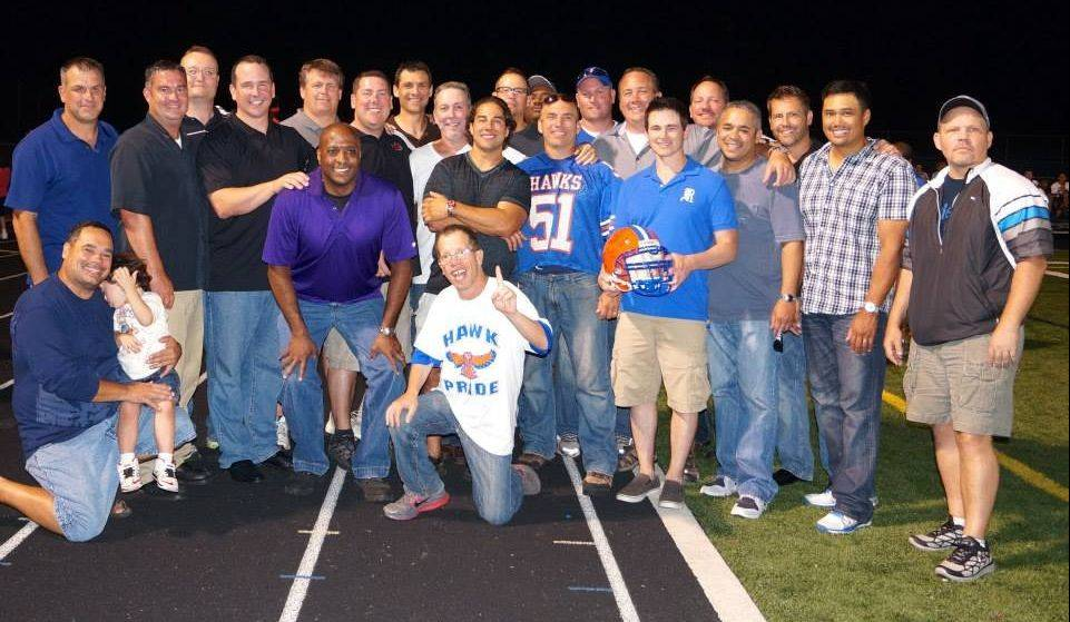 Members of the undefeated 1988 Hoffman Estates High School football team supported the current team both in person at their first home game on Sept. 6 and financially with $9,100 in donations they gathered to help the team purchase wellness and monitoring equipment.