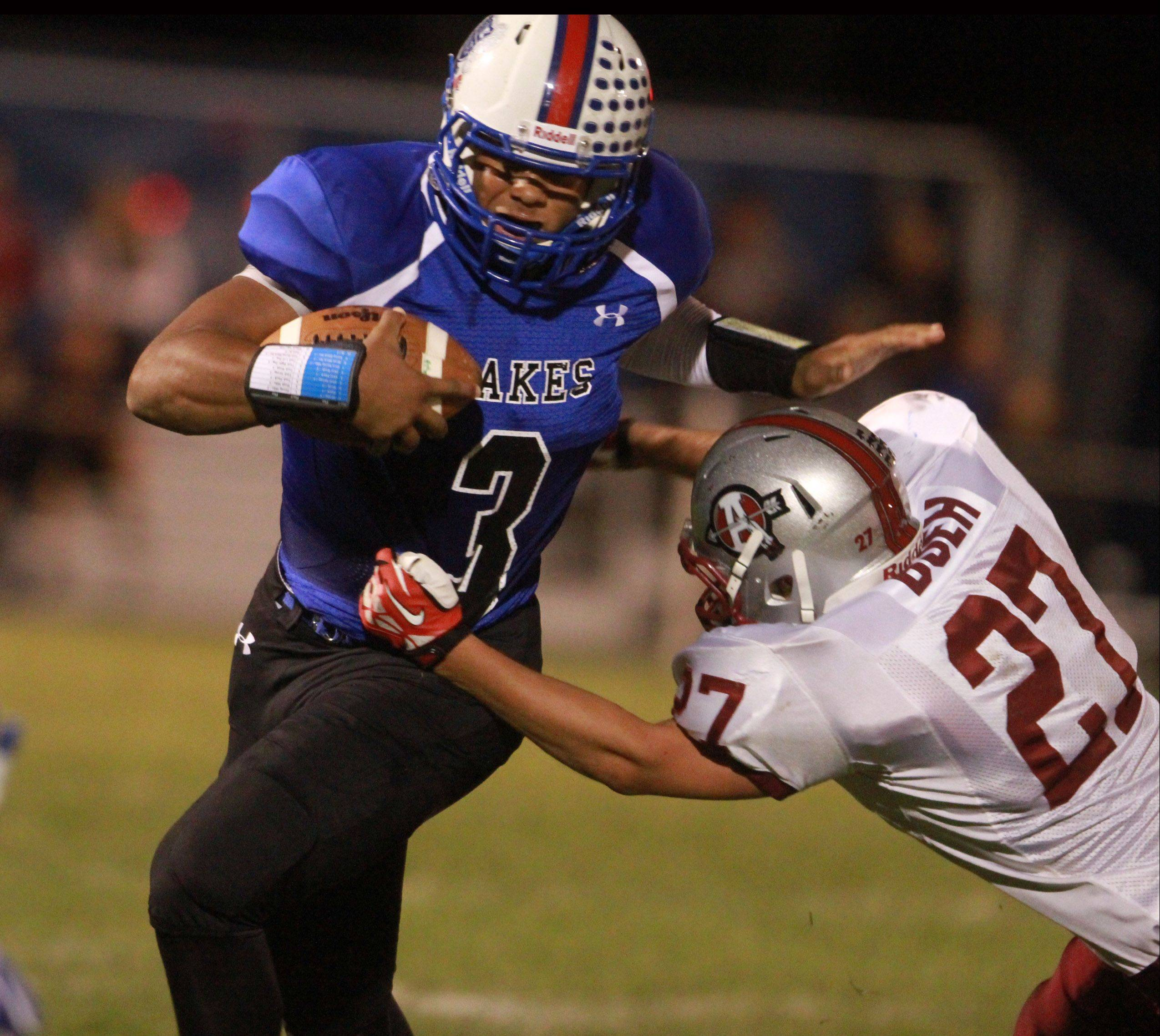 Lakes quarterback TJ Edwards tries to fend off Antioch tackler Jackson Boeh at Lakes on Friday.