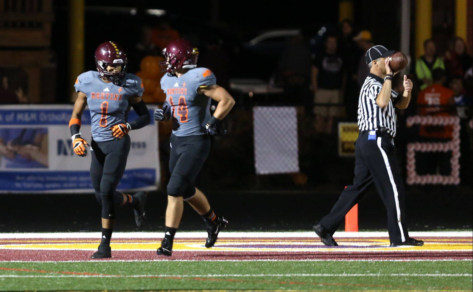 Montini's Leon Thornton, left, celebrates his first-half touchdown run with Connor Costello, right. against St. Francis.
