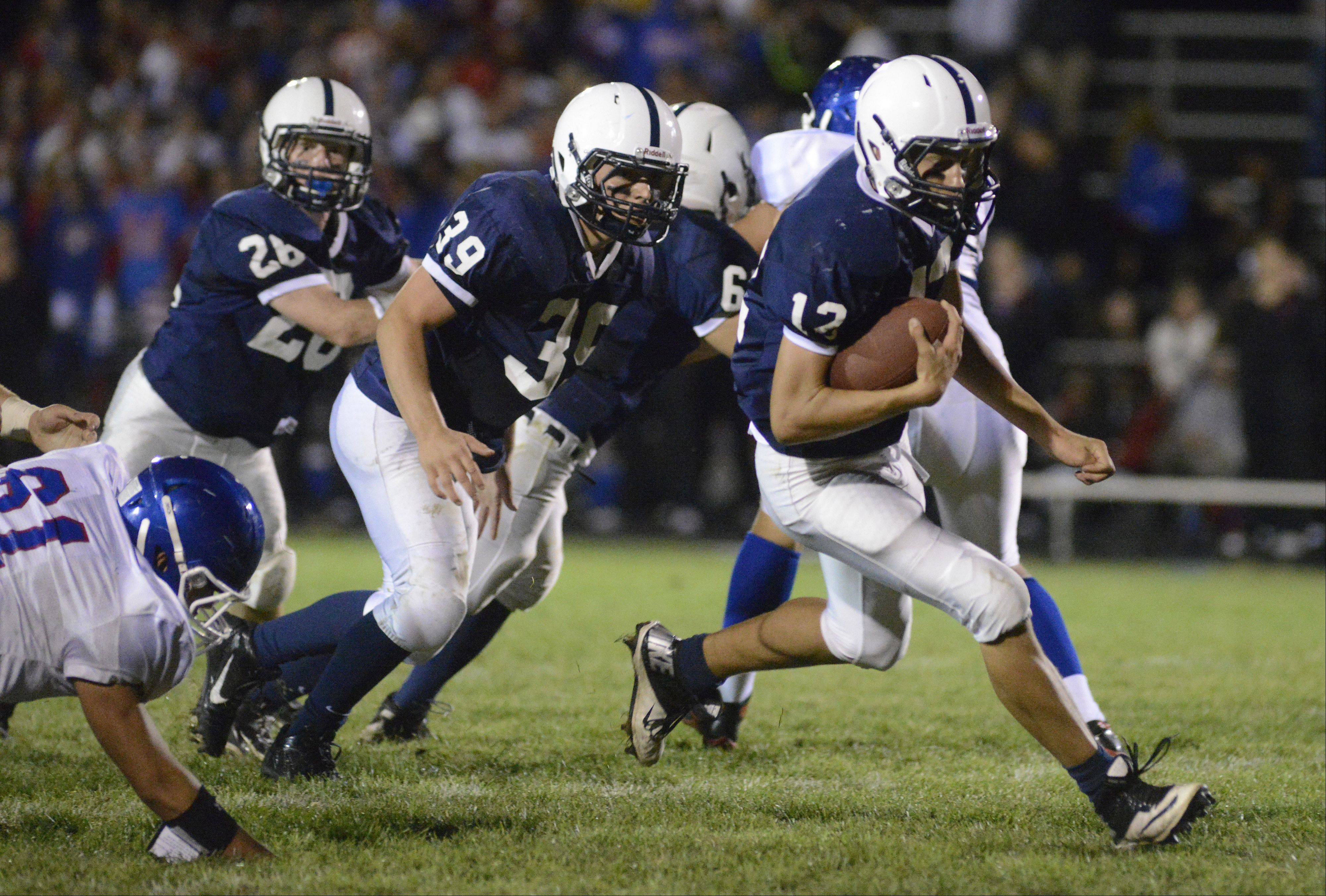 Cary-Grove quarterback Jason Gregoire runs up the center of the field.