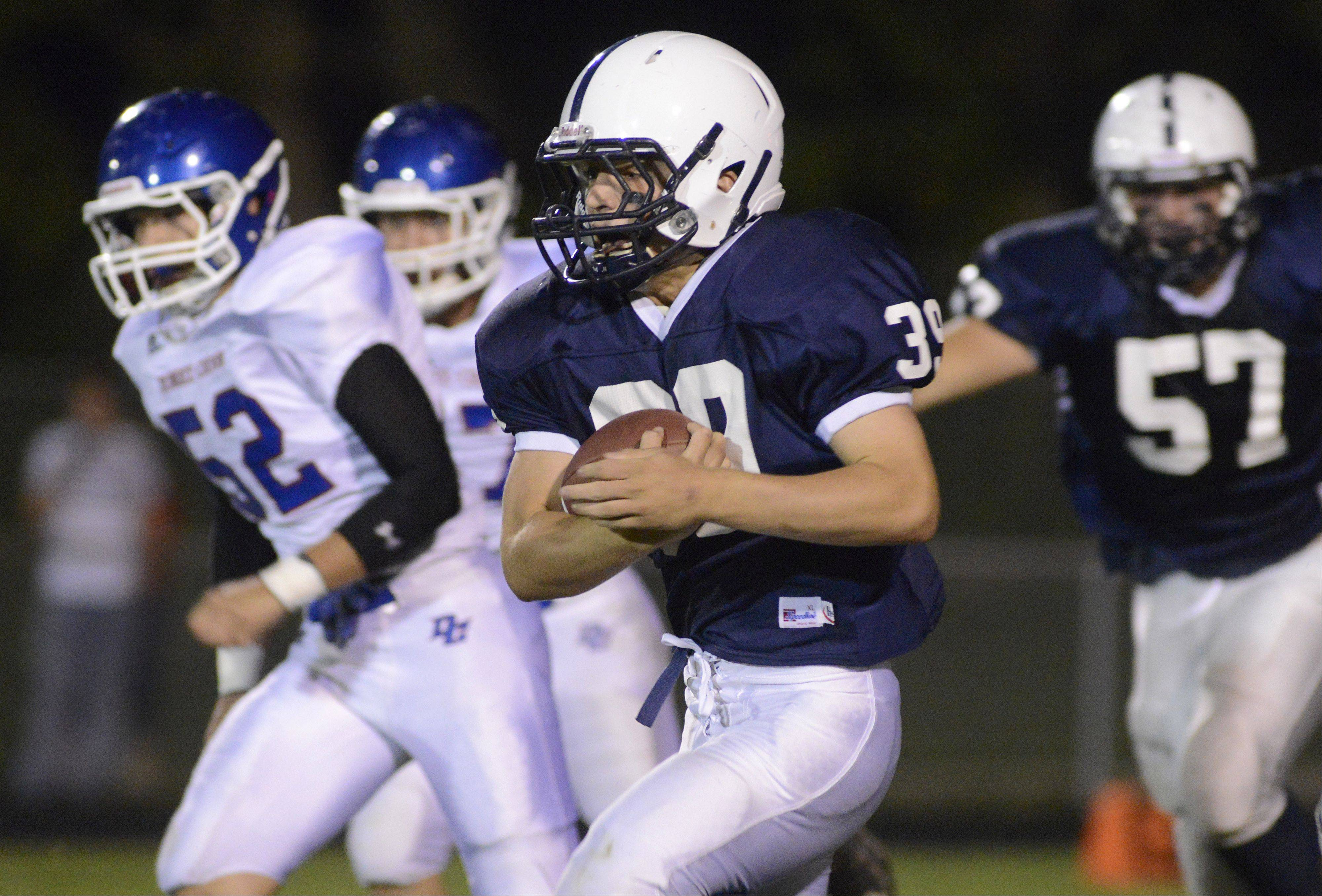 Cary-Grove's Tyler Pennington makes his way down the field in the first quarter against Dundee-Crown on Friday in Cary.