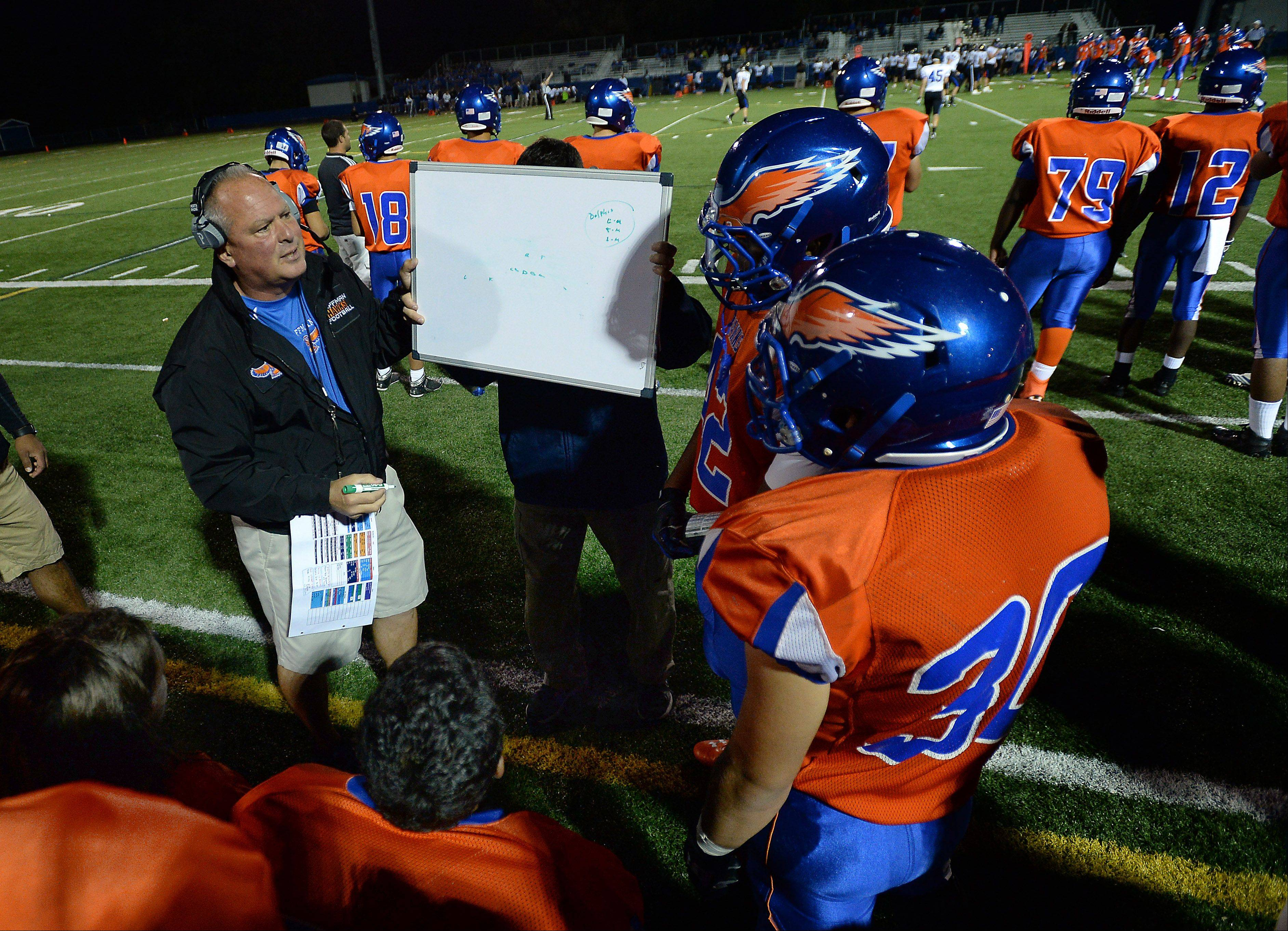Hoffman Estates' coach Mike Donatucci draws out a play for his players in the first half.