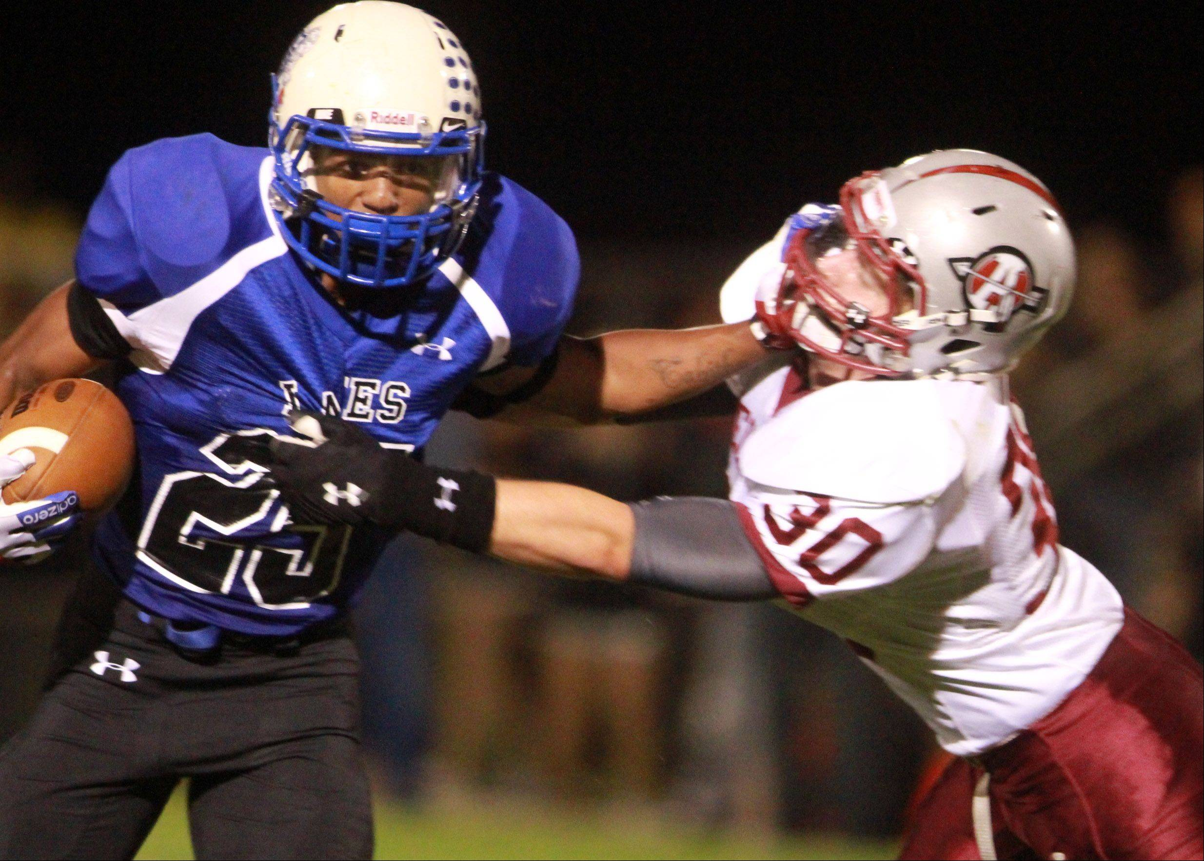 Lakes running-back Devyn Cedzidlo pushes off an Antioch defender.