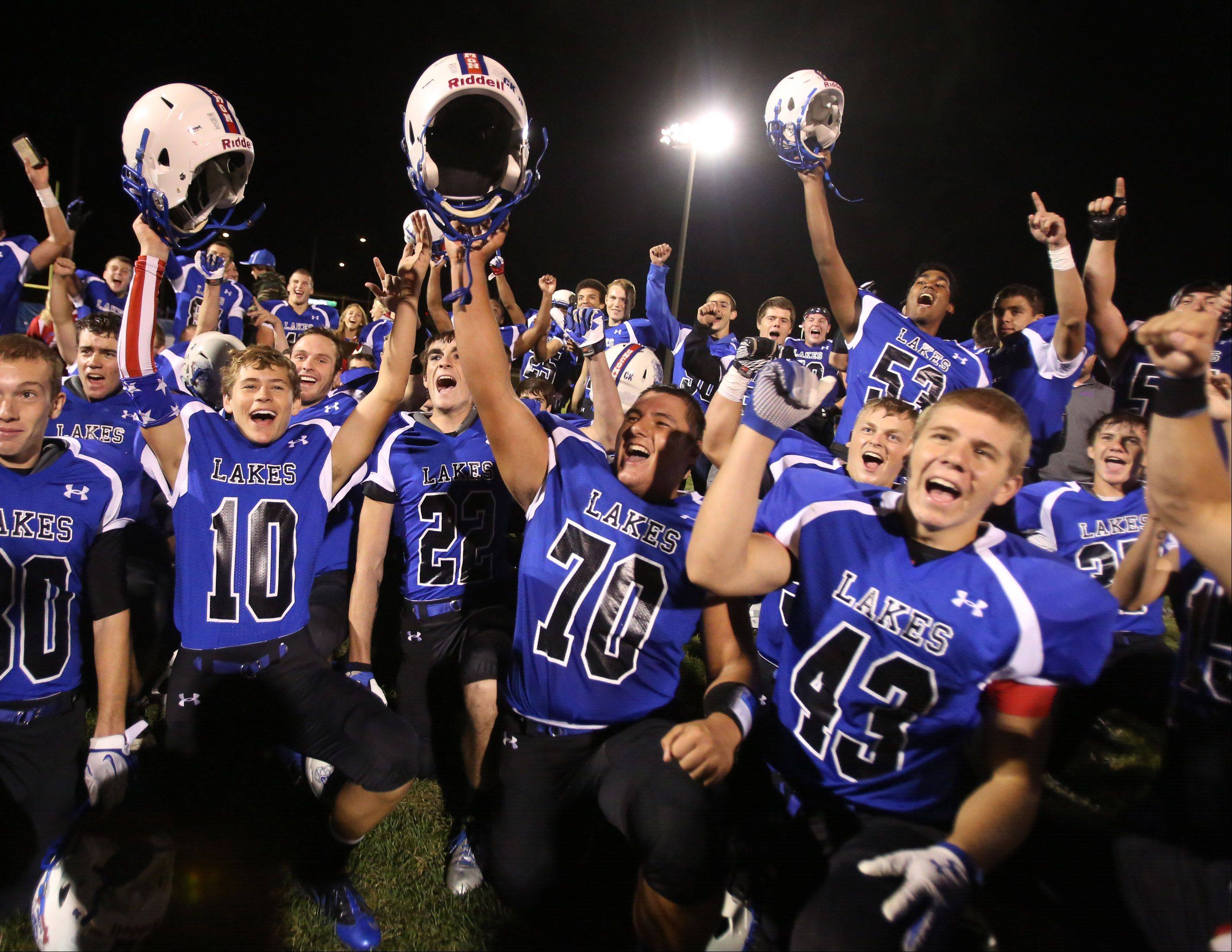 Lakes players celebrate winning 35-0 over district rival Antioch.