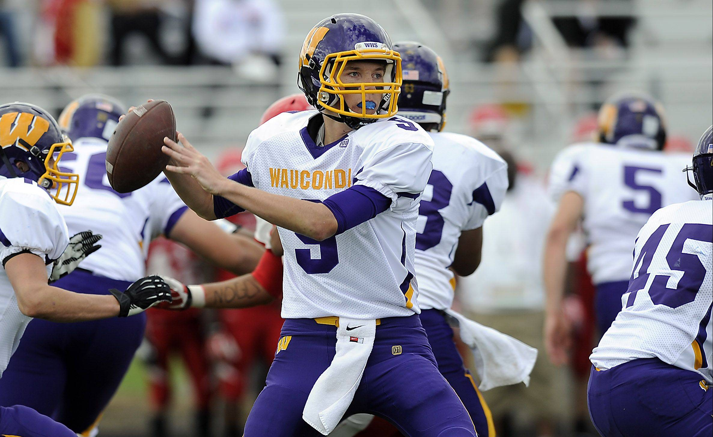 Wauconda's Kevin Malisheski looks for a receiver downfield and fires to Josh Anderson in the first half at North Chicago on Saturday.