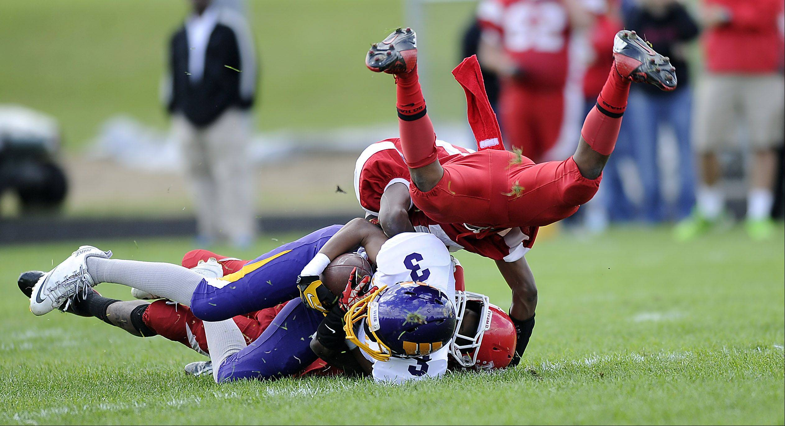 Wauconda's Josh Anderson is tackled by Tazari Bryant for short yardage in the first half of varsity football at North Chicago High School on Saturday.