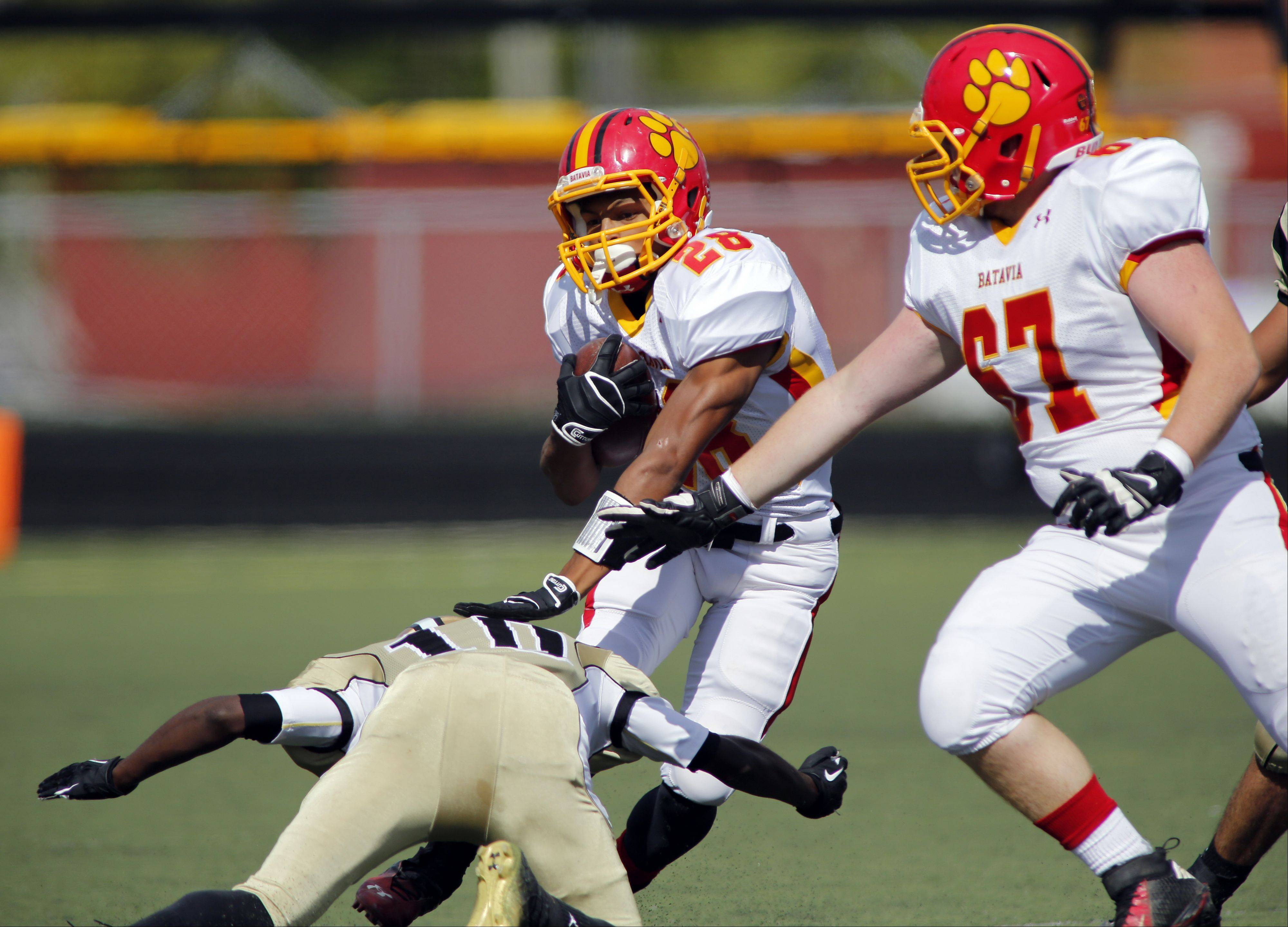 Batavia's Anthony Scaccia works upfield past Streamwood's Jelyn Hill, during Batavia at Streamwood football Saturday at Millennium Field at Streamwood High School.