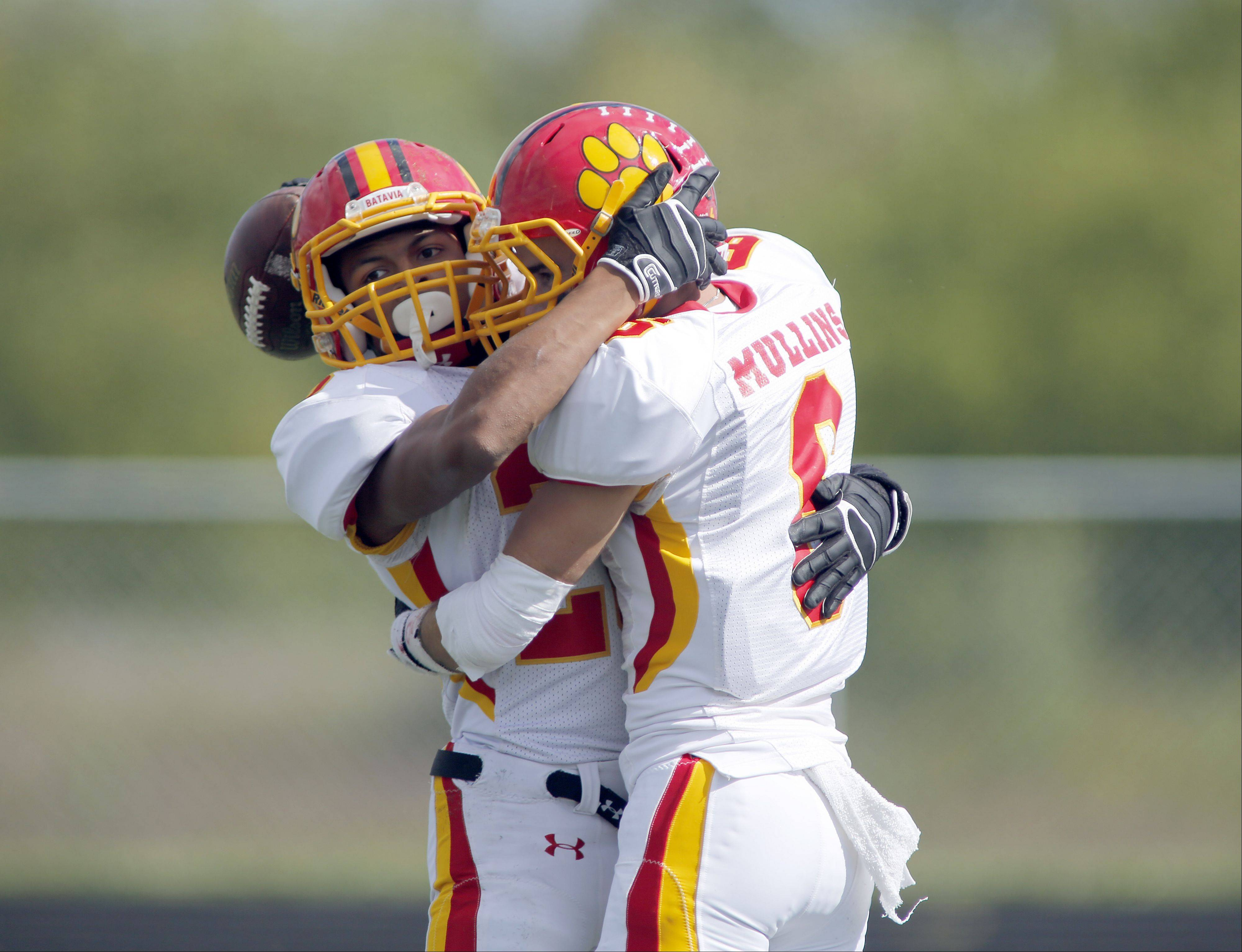 Batavia's Anthony Scaccia, and Rourke Mullins celebrate a touchdown during Batavia at Streamwood football Saturday at Millennium Field at Streamwood High School.