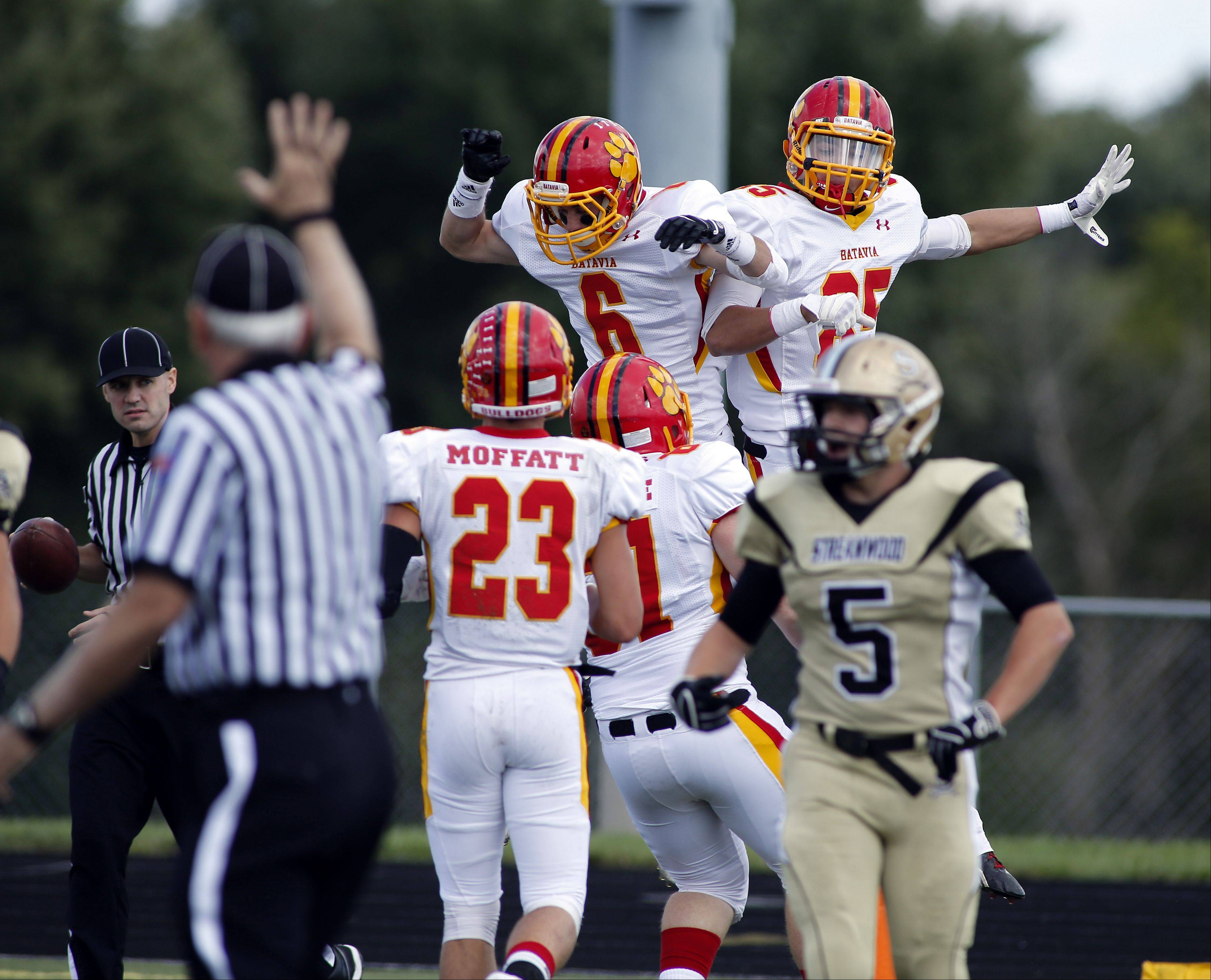 Batavia's Rourke Mullins and Jordan Zwart celebrate a touchdown during Batavia at Streamwood football Saturday at Millennium Field at Streamwood High School.