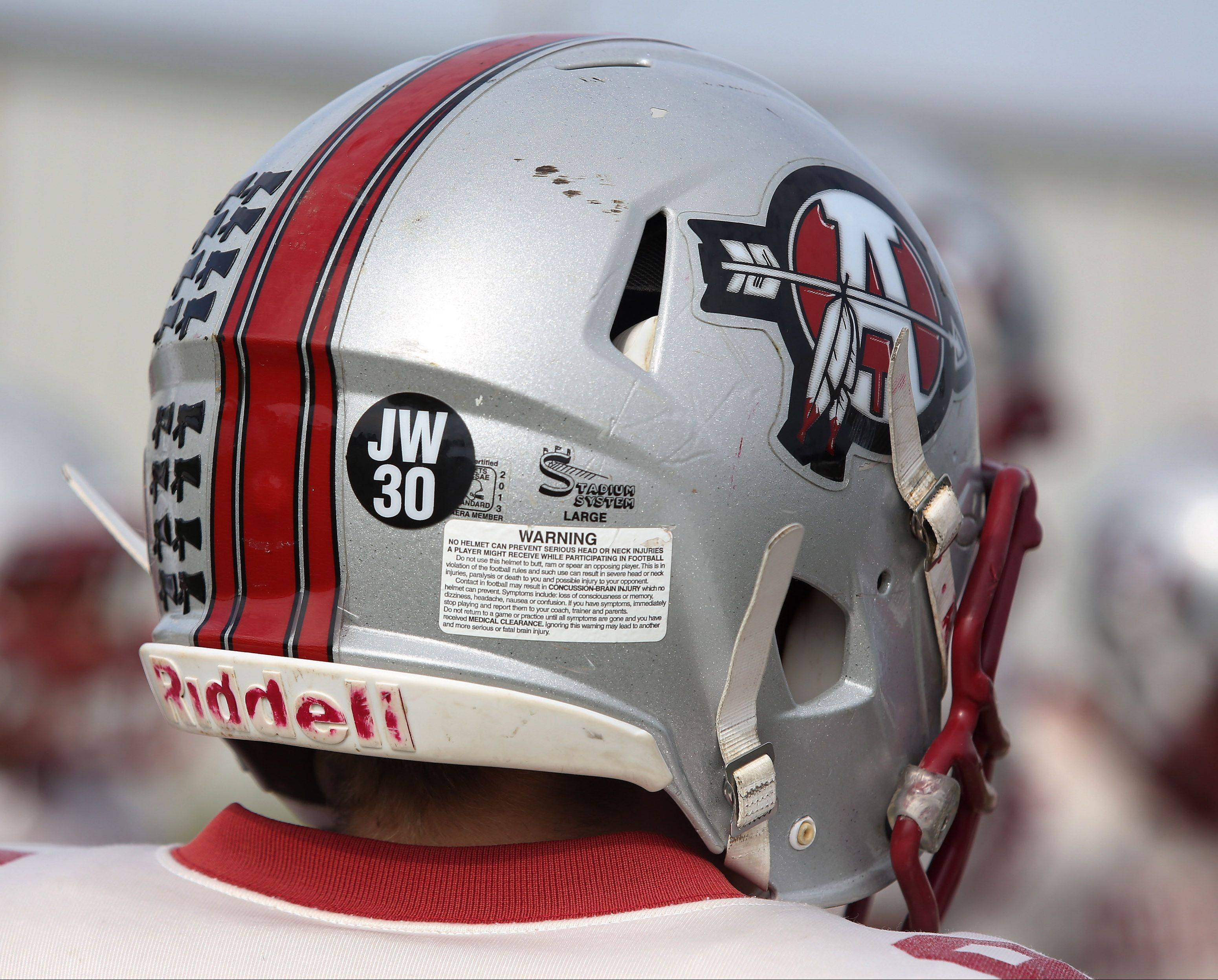 "Antioch football players wear a decal with ""JW 30"" on their helmets in memory of former teammate Joel Wittkamp."