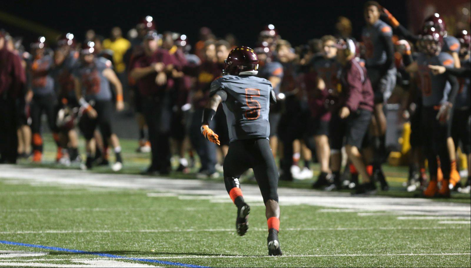 Montini's Derrick Curry picks off a St. Francis pass for a 92-yard touchdown run.